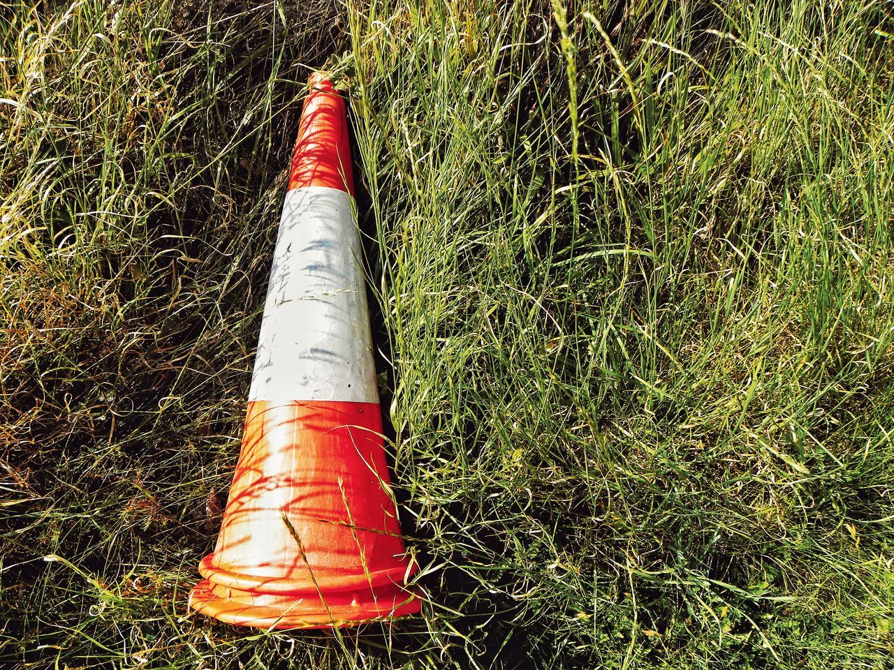 High Angle View No People Outdoors Close-up Day Cone Traffic Sign Traffic Cone Grass Traffic Abandoned Abandoned Cone Object Left On The Grass Accident Traffic Accident Sign Traffic Signs Red