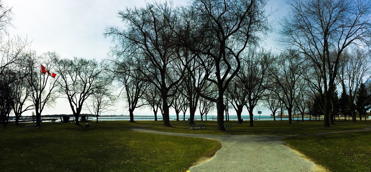 Going for a quick walkabout to stretch me legs. Toronto Lake Ontario Coronation Park Spring Has Arrived Park IPhoneography Canada Flag
