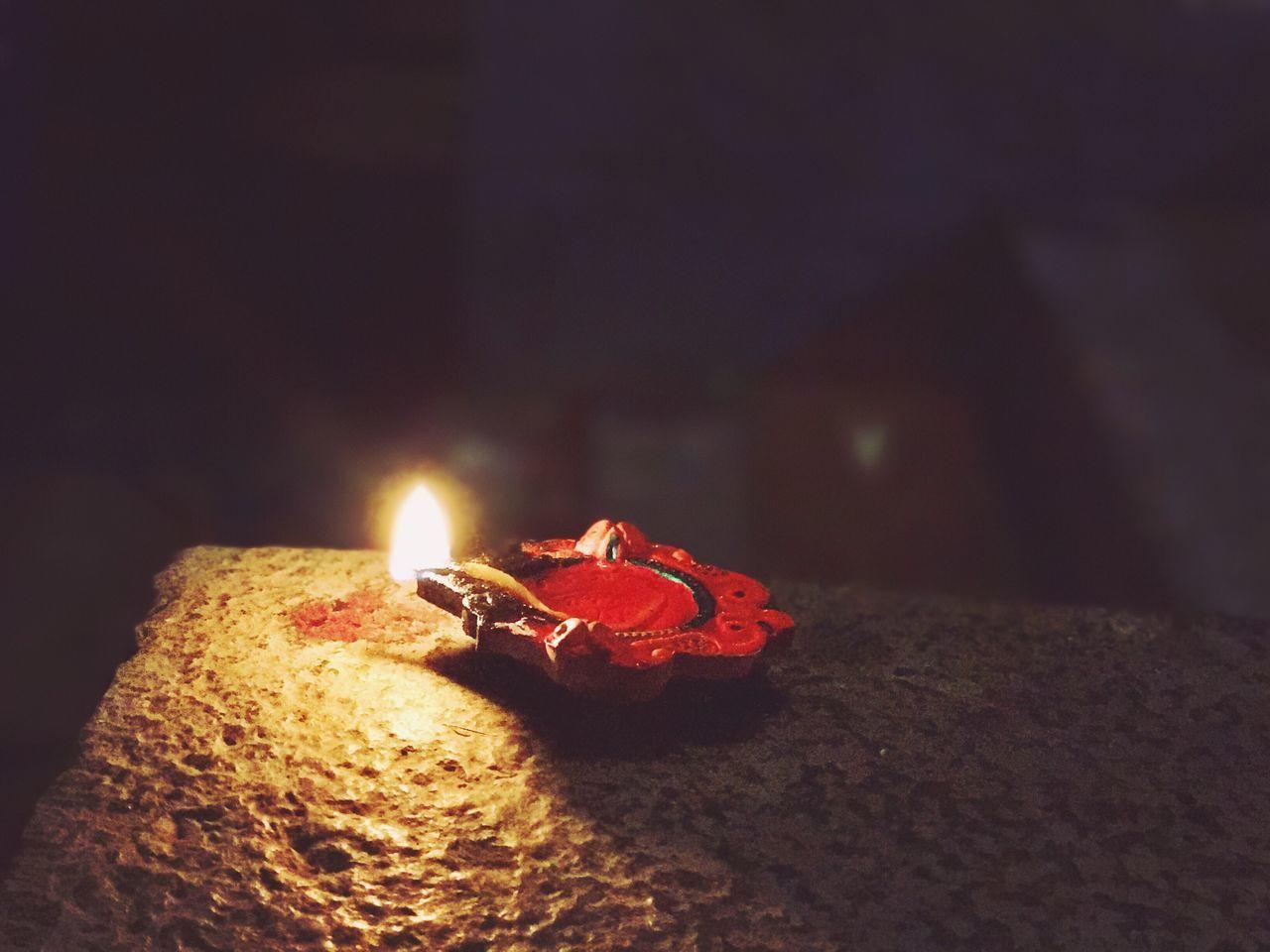 flame, burning, heat - temperature, candle, night, glowing, illuminated, close-up, diya - oil lamp, celebration, no people, diwali, indoors, oil lamp