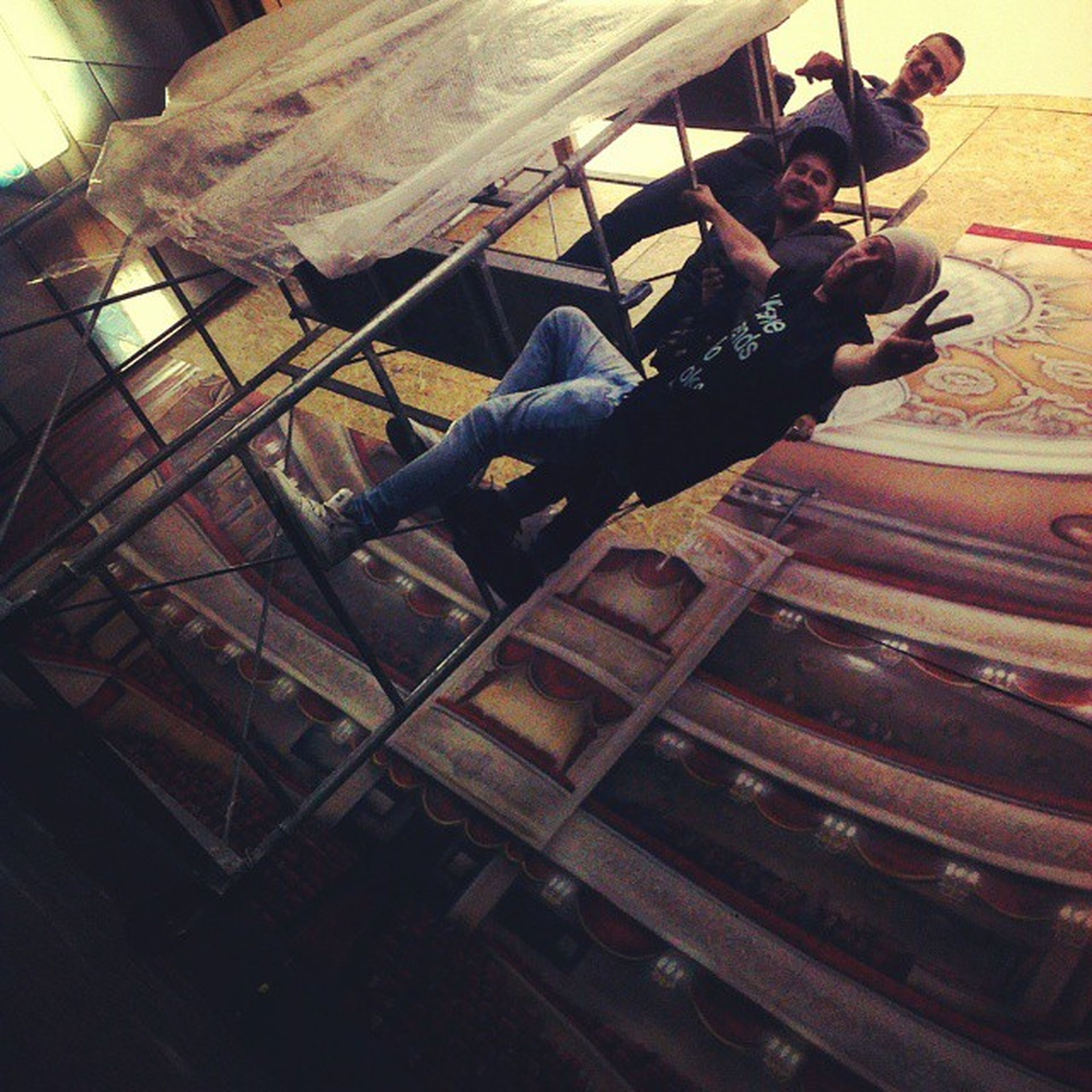 indoors, lifestyles, full length, sitting, working, leisure activity, casual clothing, young adult, occupation, high angle view, men, skill, young men, arts culture and entertainment, side view, person, day, sunlight