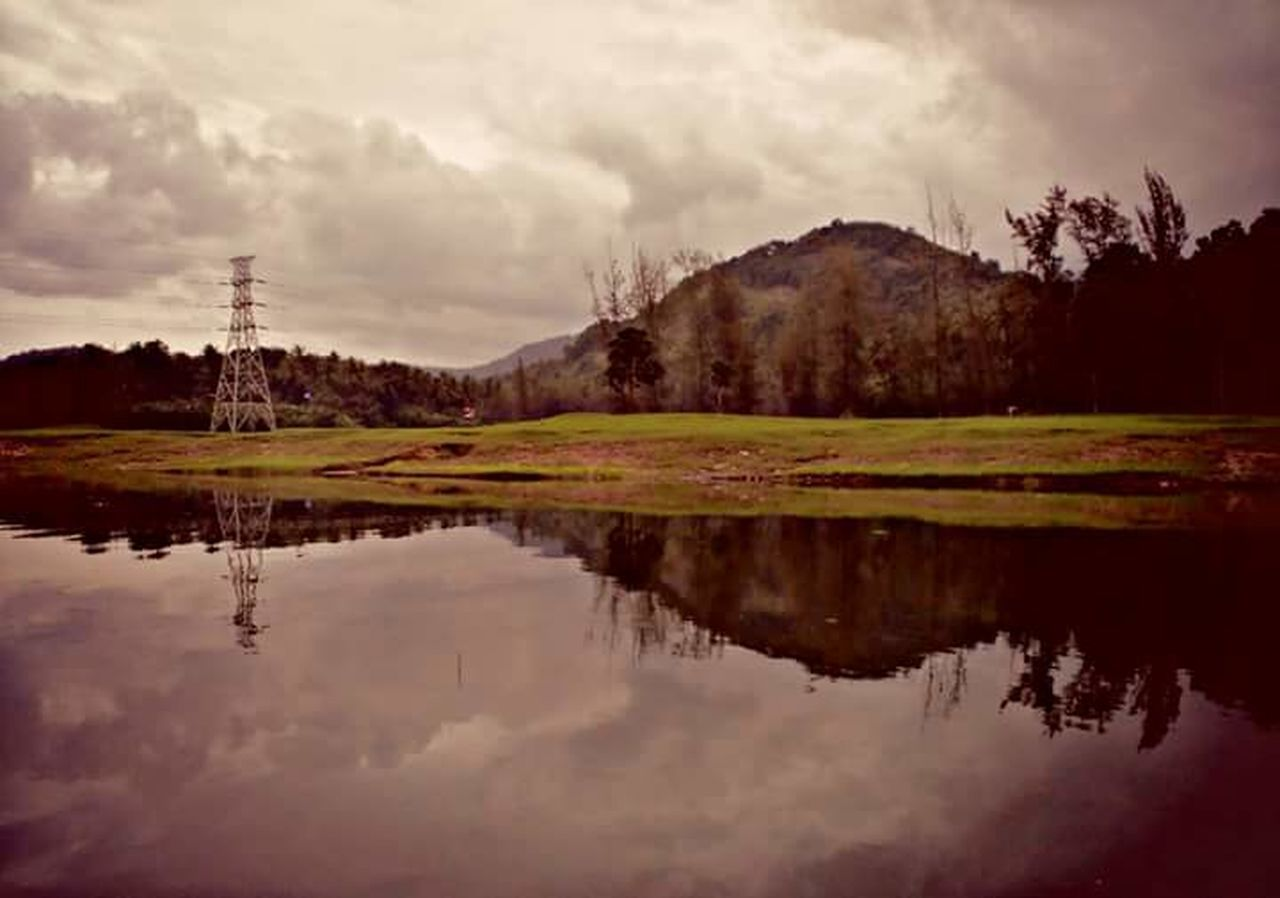 reflection, lake, cloud - sky, nature, water, scenics, tranquil scene, sky, tranquility, outdoors, no people, mountain, beauty in nature, tree, travel destinations, day, landscape, grass, golf course