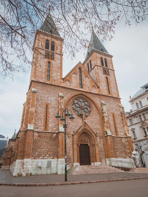 Sacred Heart Cathedral in Sarajevo Anicentsite Architecture Archival Bosnia And Herzegovina Building Exterior Built Structure Cathedral Catholic Church City Cristianity Day Exterior Ferhadija Historic Landmark No People Old Outdoors Place Of Worship Religion Sacred Heart Sarajevo Spirituality Stone
