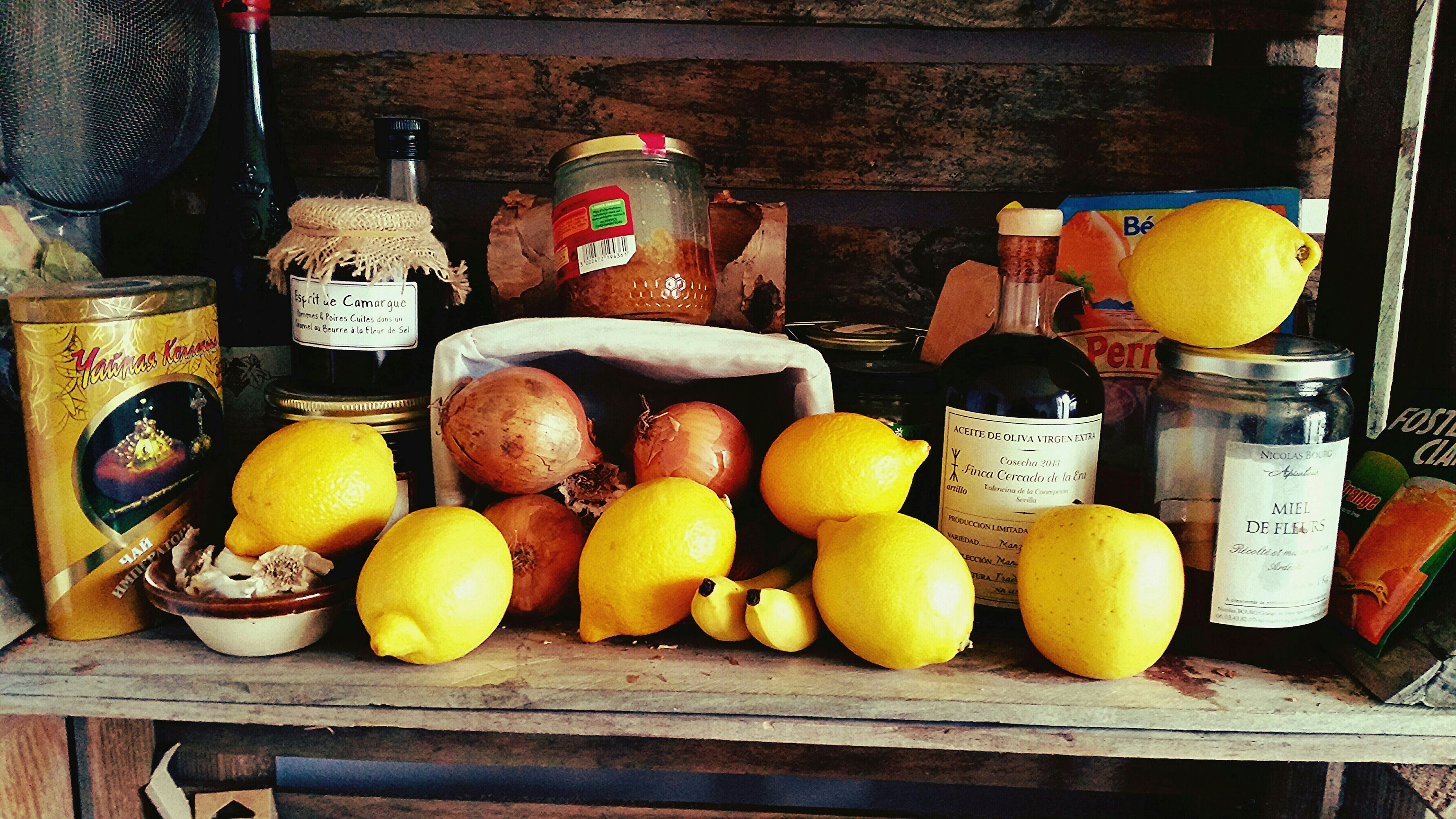 food and drink, food, freshness, fruit, healthy eating, still life, yellow, orange - fruit, large group of objects, variation, wood - material, abundance, table, indoors, choice, citrus fruit, for sale, apple - fruit, lemon, high angle view