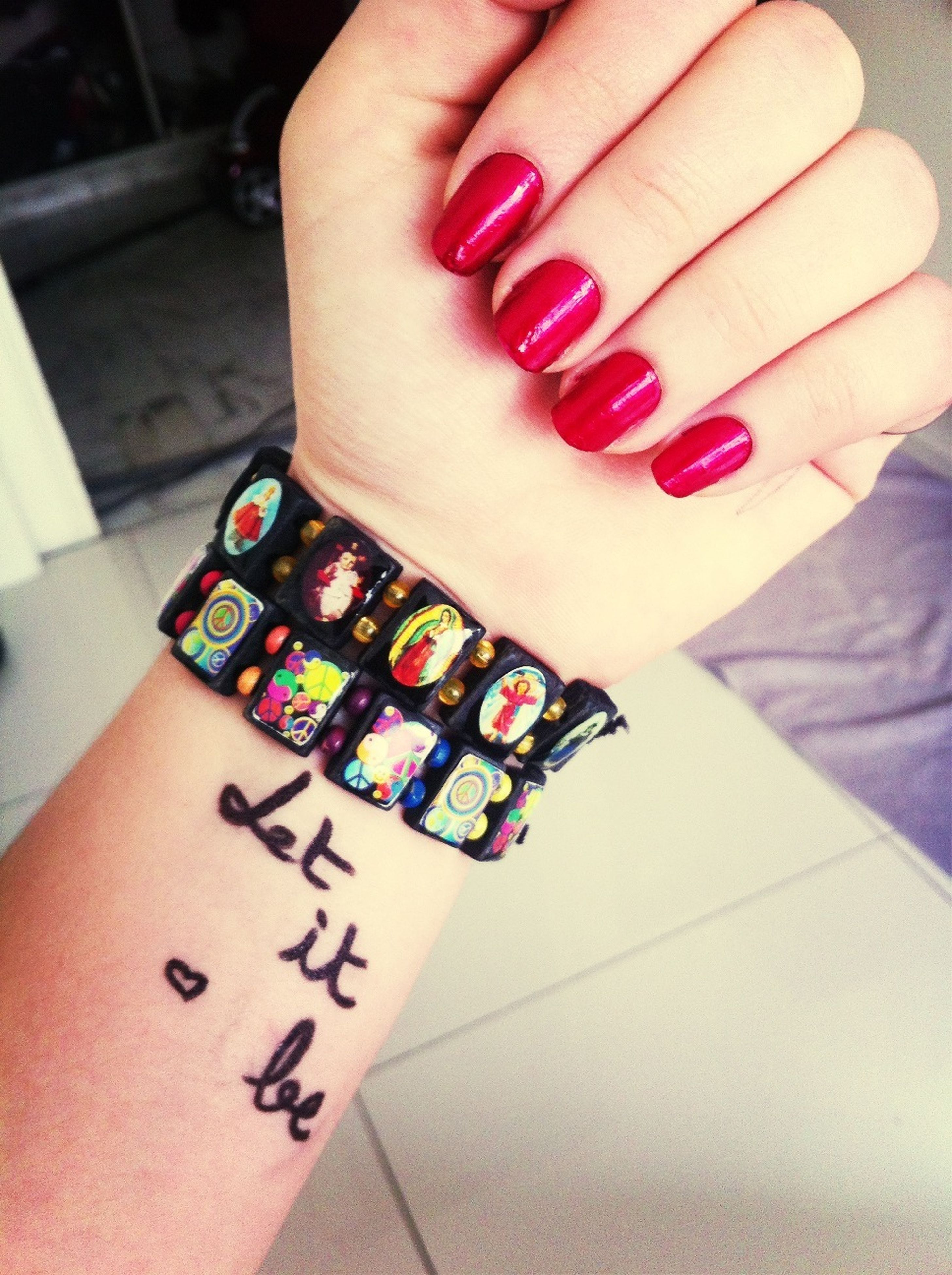 indoors, person, part of, high angle view, text, human finger, communication, close-up, table, cropped, western script, number, holding, nail polish, unrecognizable person, jewelry