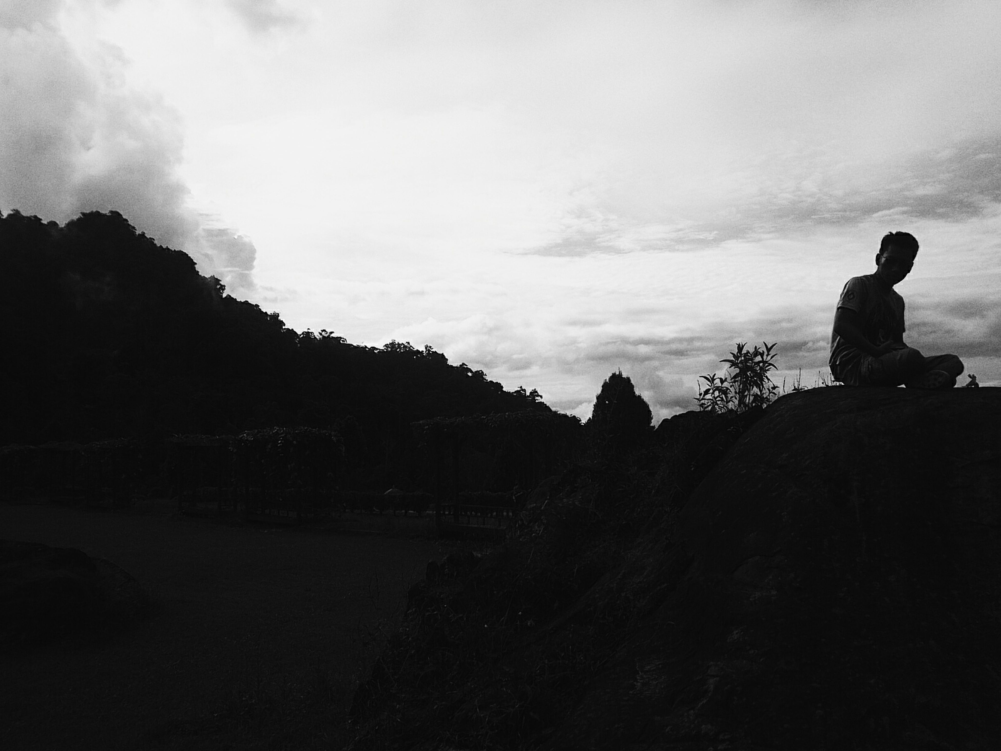 silhouette, sky, leisure activity, lifestyles, men, cloud - sky, tranquility, standing, tranquil scene, full length, rock - object, nature, scenics, rear view, beauty in nature, person, cloud