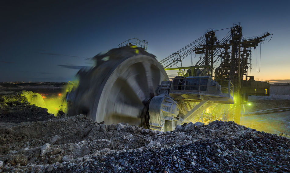 Russia, Stary Oskol, Stoilensky GOK, bucket wheel excavator, Stripping Bucket Wheel Excavator Glowing Illuminated Landscape Light Trail Motion Nature Night No People Outdoors Russia россия Sky Smoke - Physical Structure Stripping The Land Travel Destinations