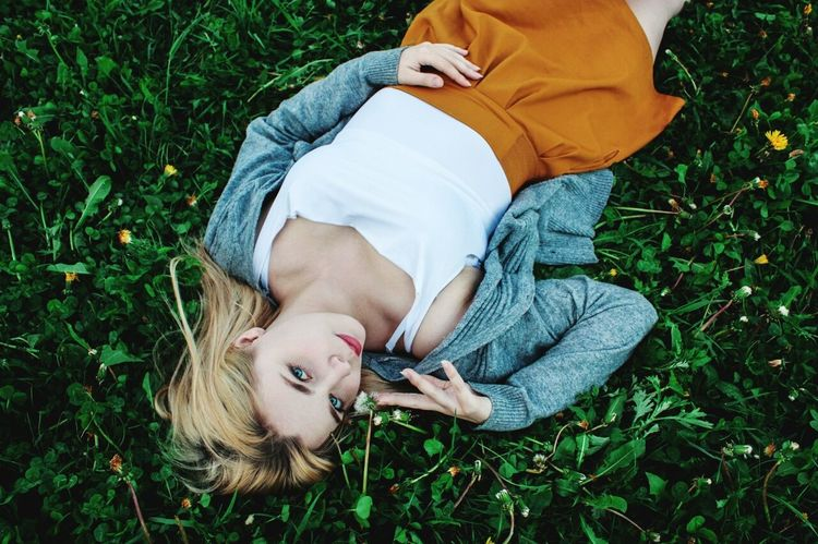 Lying Down Grass Lying On Back Relaxation Portable Information Device Smart Phone Child Mobile Phone Adult Men Technology Wireless Technology One Person Communication People Lifestyles Sleeping Young Adult Outdoors Young Women