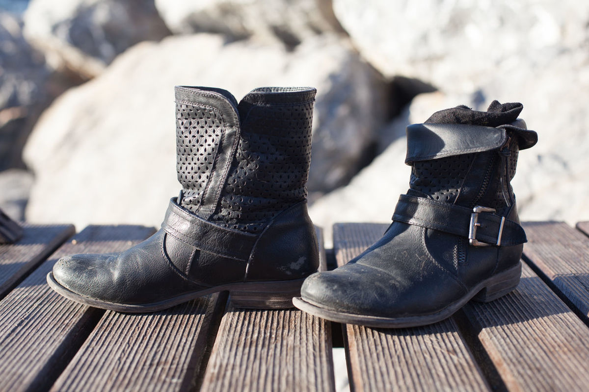 These Boots are mad for Rocking! Boot Boots Buckle Buckles Close-up Day Empty Eye4photography  EyeEm EyeEm Best Edits EyeEm Best Shots EyeEm Gallery EyeEmBestPics Focus On Foreground Leather Leather Boots Leather Craft Nature No People Outdoors Rock Rocks Seat Selective Focus Wooden