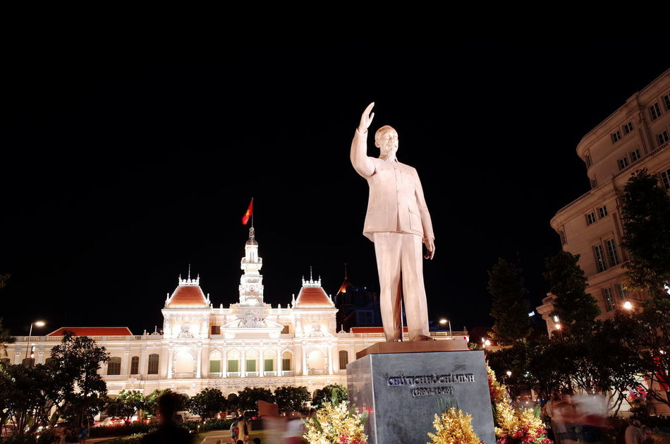 Architecture Art Built Structure Creativity Famous Place Ho Chi Minh City Human Representation Illuminated Low Angle View Nguyen Hue St Night People's Committee Saigon Night Sculpture Sky Spirituality Statue Tourism Travel Destinations Uncle Ho
