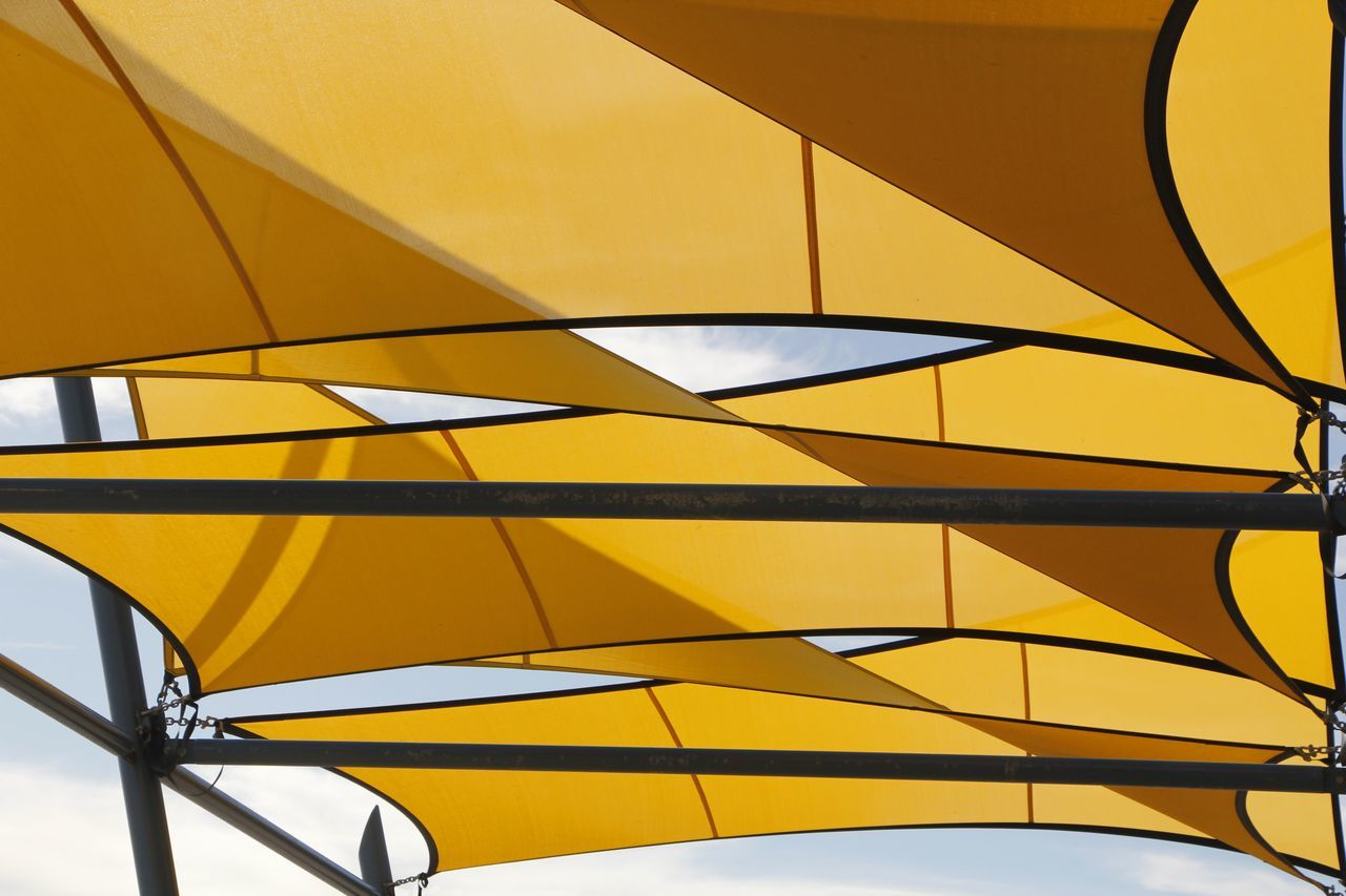 Shade Sails spread to provide protective sun cover Abstract Abstract Photography Arcitecture Built Structure Close-up Cover Protection Day Decoration Decorative Design Designing Low Angle View Modern No People Pattern Prevent Shadeclo Shadecloth Shadow Style Sun Sunblock Sunset Sunshade Yellow