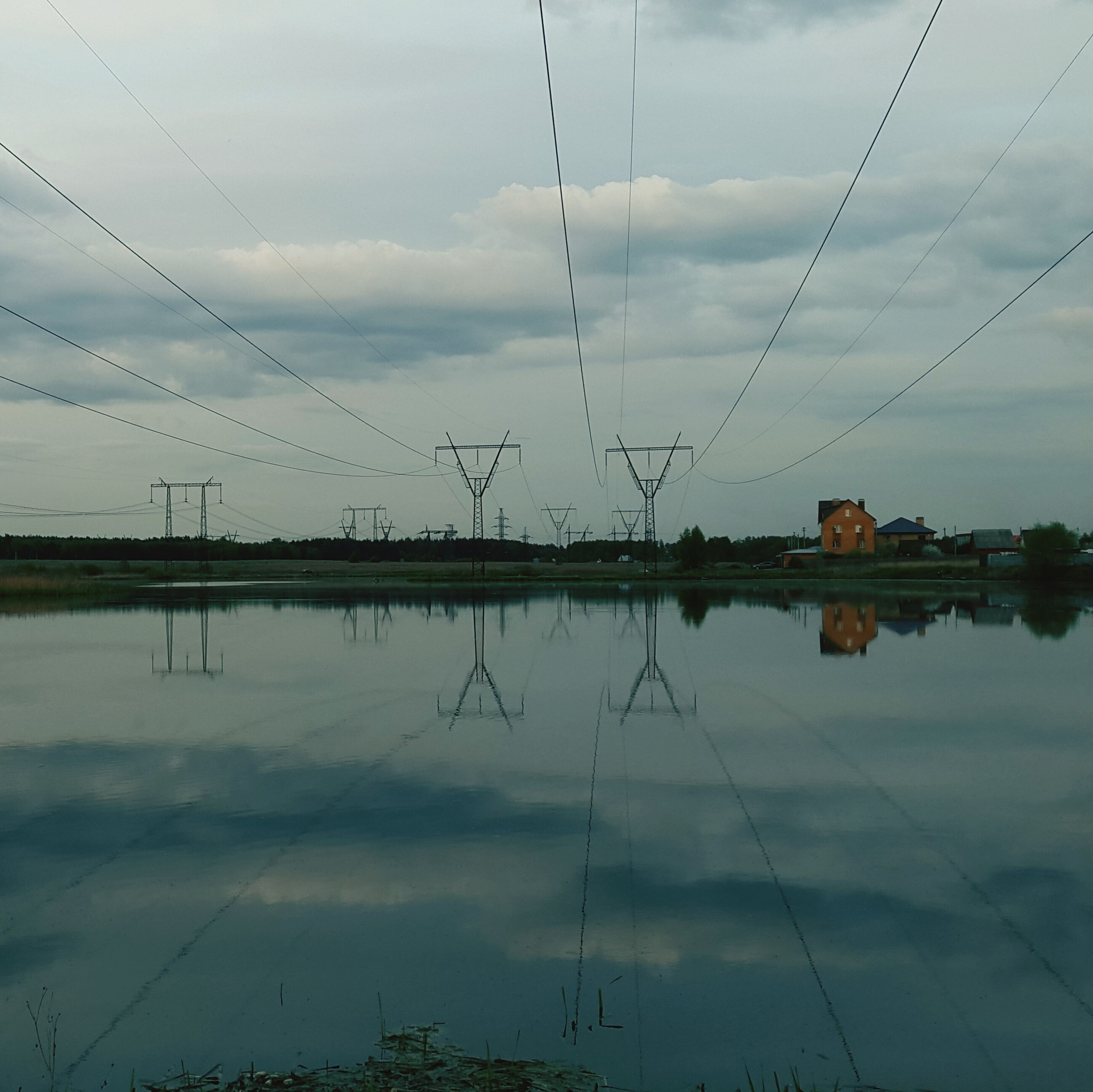 sky, water, reflection, cloud - sky, cloudy, power line, cloud, electricity pylon, lake, connection, standing water, tranquility, nature, fuel and power generation, electricity, weather, built structure, cable, tranquil scene, waterfront