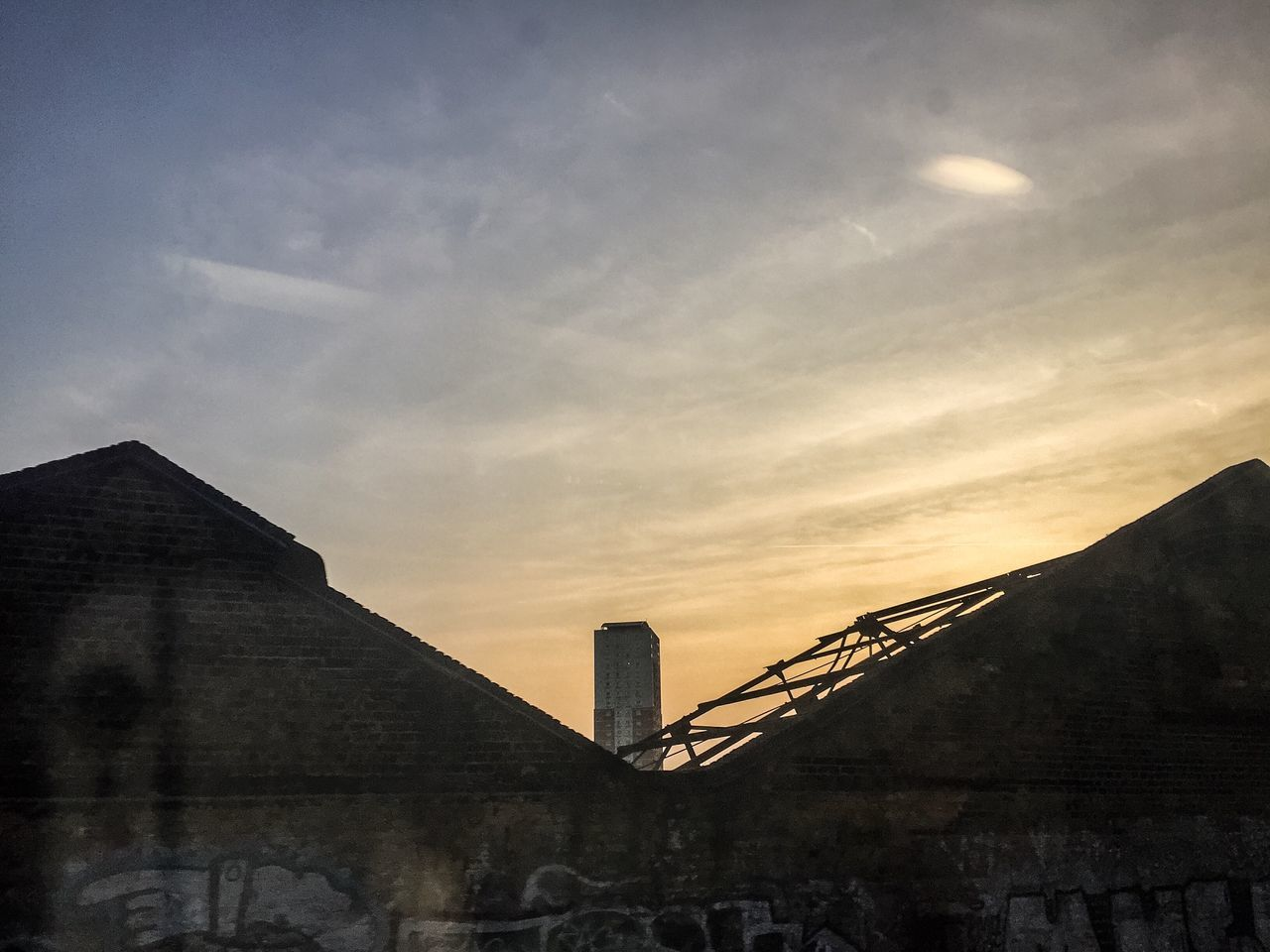 Warehouses Tower Block  Sunset Graffiti Blue Sky Cloud Trails Timber Beam Train Travel Out The Window  Derelict Building Blue Yellow