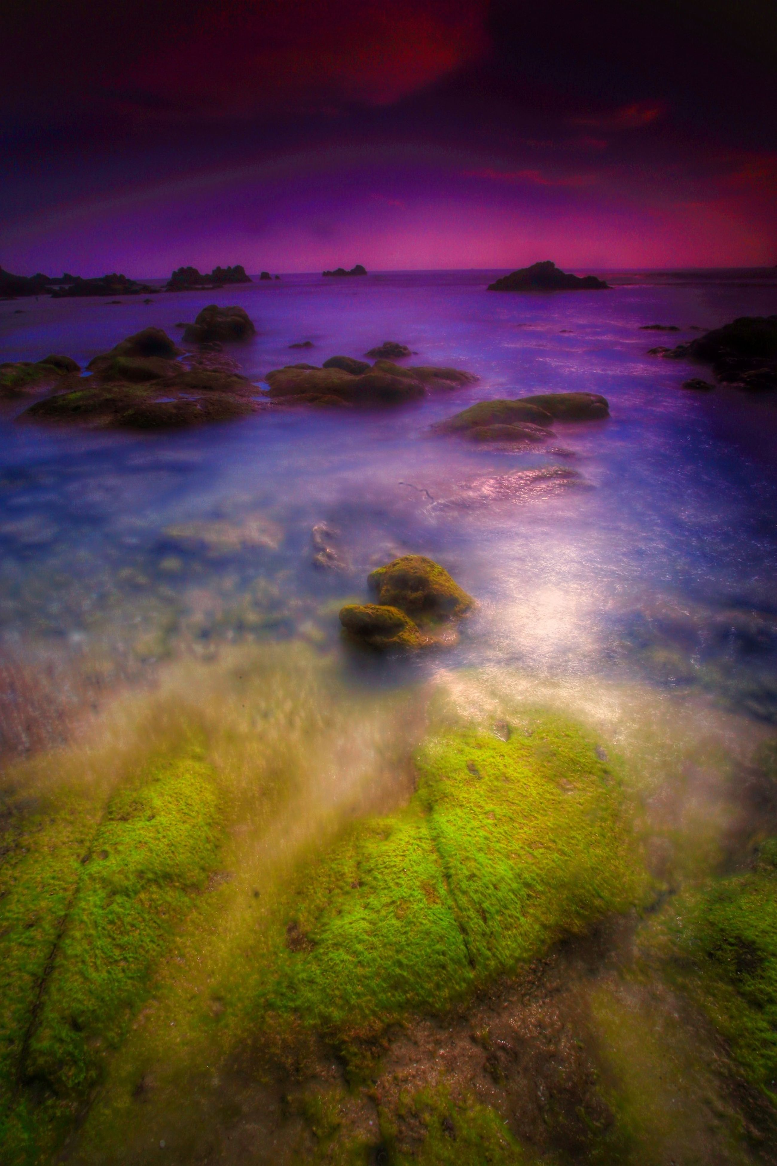 tranquil scene, scenics, water, tranquility, sky, beauty in nature, sea, sunset, nature, cloud - sky, idyllic, horizon over water, grass, dusk, beach, landscape, plant, outdoors, dramatic sky, shore