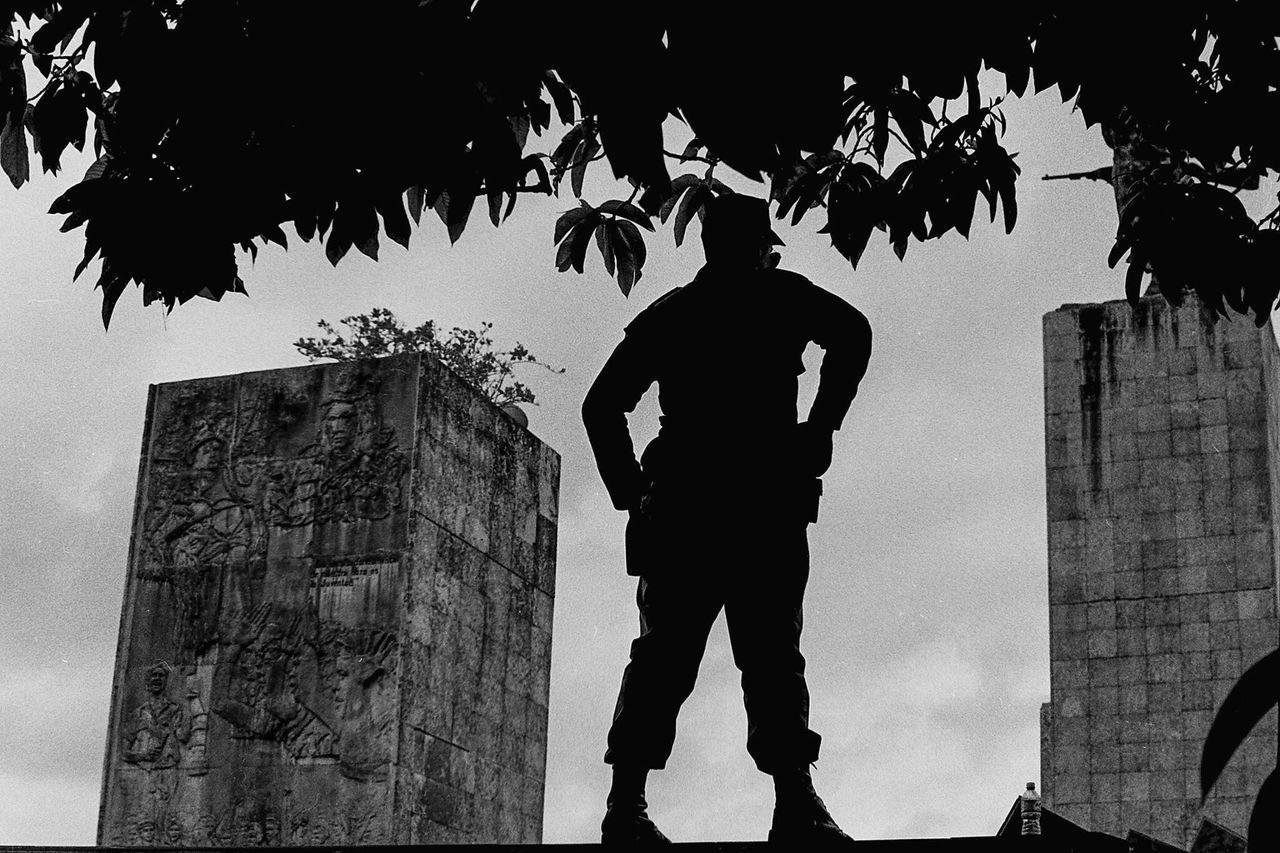 Soldier standing guard at Che Guevara memorial Cuba Che Guevara Soldier Guard Guardian Silhouette TriX400 Film Photography Black And White Filmisnotdead Santa Clara