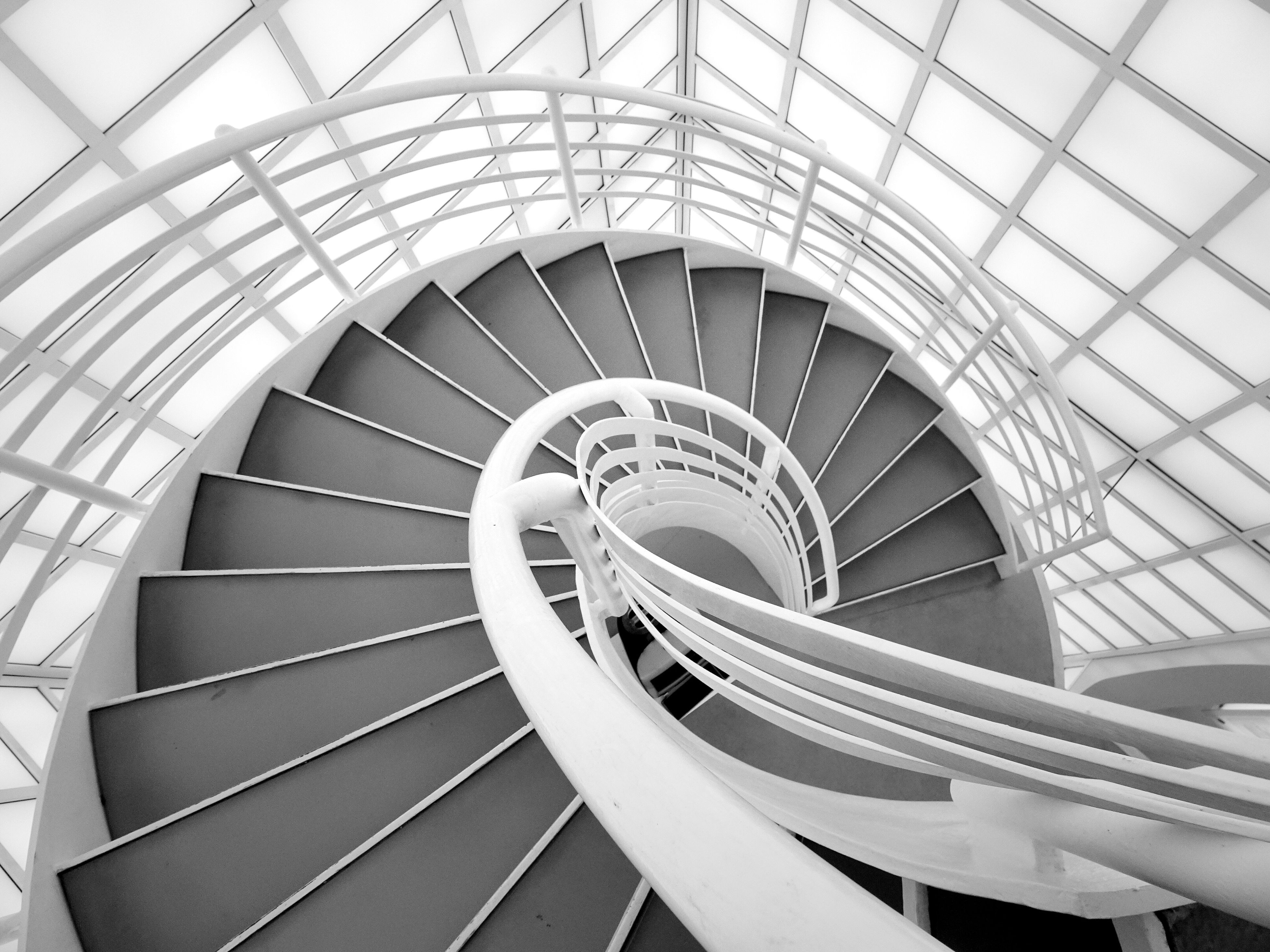 spiral, steps and staircases, staircase, steps, railing, built structure, architecture, spiral stairs, stairs, day, low angle view, indoors, no people