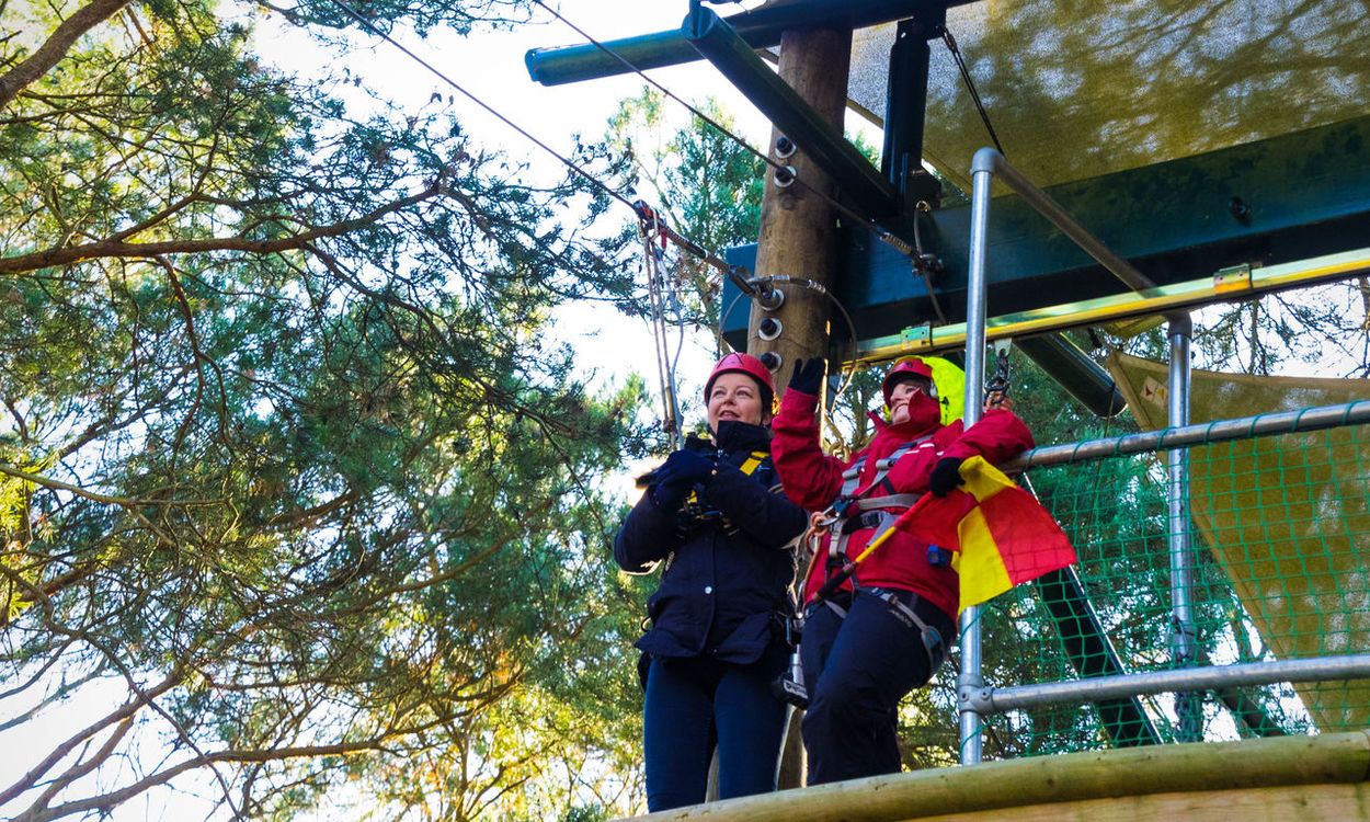 High Wait Adult Adults Only Day Forest Jump Headwear High Wire Industry Low Angle View Men Mid Adult Mid Adult Men Occupation Outdoors People Sky Standing Teamwork Togetherness Tree Two People Waiting For The Thrill