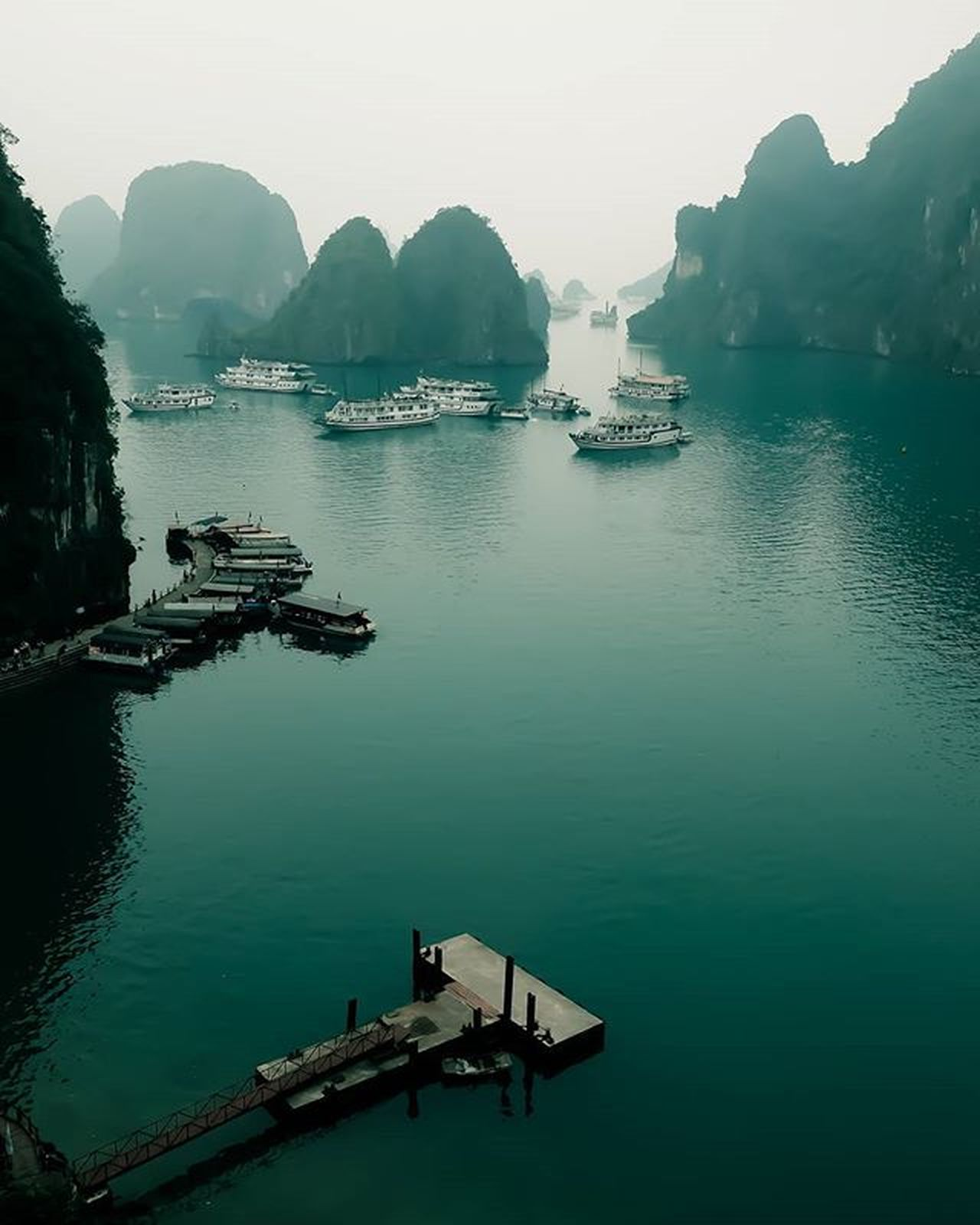 "March 11th 2016 7 Wonders of the World ( Nature ) Hạ Long Bay (Vietnamese: Vịnh Hạ Long : ""descending dragon bay"") is a UNESCO World Heritage Site, and a popular travel destination, in Quảng Ninh Province, North Vietnam. The bay features thousands of limestone karsts and isles in various sizes and shapes with a 120 kilometre long coastline and is approximately 1,553 square kilometres in size with 1969 islets. Several of the islands are hollow, with enormous caves, other support floating villages of fishermen, who ply the shallow waters for 200 species of fish and 450 different kinds of mollusks. Another specific feature of Halong Bay is the abundance of lakes inside the limestone islands, for example, Dau Be island has six enclosed lakes. All these island lakes occupy drowned dolines within fengcong karst. Nature Vietnam Halong Bay ASIA Onassignment Destination Travel Travelphotography Indochina Fuji Fujifilm Xt1 Fujixseries Landscape Ig_malaysia_ Landscapes With WhiteWall 7 Wonders Of The World Things I Like"