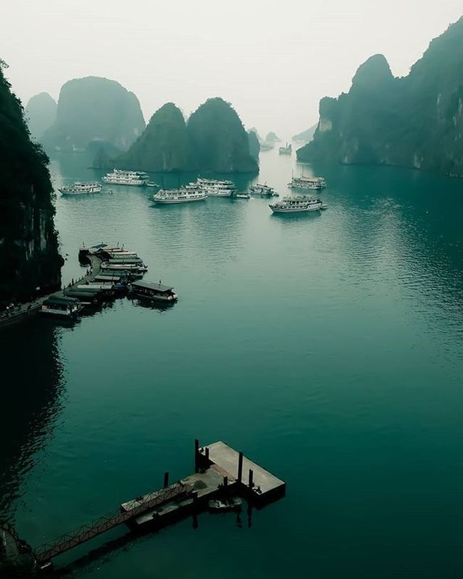 """March 11th 2016 7 Wonders of the World ( Nature ) Hạ Long Bay (Vietnamese: Vịnh Hạ Long : """"descending dragon bay"""") is a UNESCO World Heritage Site, and a popular travel destination, in Quảng Ninh Province, North Vietnam. The bay features thousands of limestone karsts and isles in various sizes and shapes with a 120 kilometre long coastline and is approximately 1,553 square kilometres in size with 1969 islets. Several of the islands are hollow, with enormous caves, other support floating villages of fishermen, who ply the shallow waters for 200 species of fish and 450 different kinds of mollusks. Another specific feature of Halong Bay is the abundance of lakes inside the limestone islands, for example, Dau Be island has six enclosed lakes. All these island lakes occupy drowned dolines within fengcong karst. Nature Vietnam Halong Bay ASIA Onassignment Destination Travel Travelphotography Indochina Fuji Fujifilm Xt1 Fujixseries Landscape Ig_malaysia_ Landscapes With WhiteWall 7 Wonders Of The World Things I Like"""