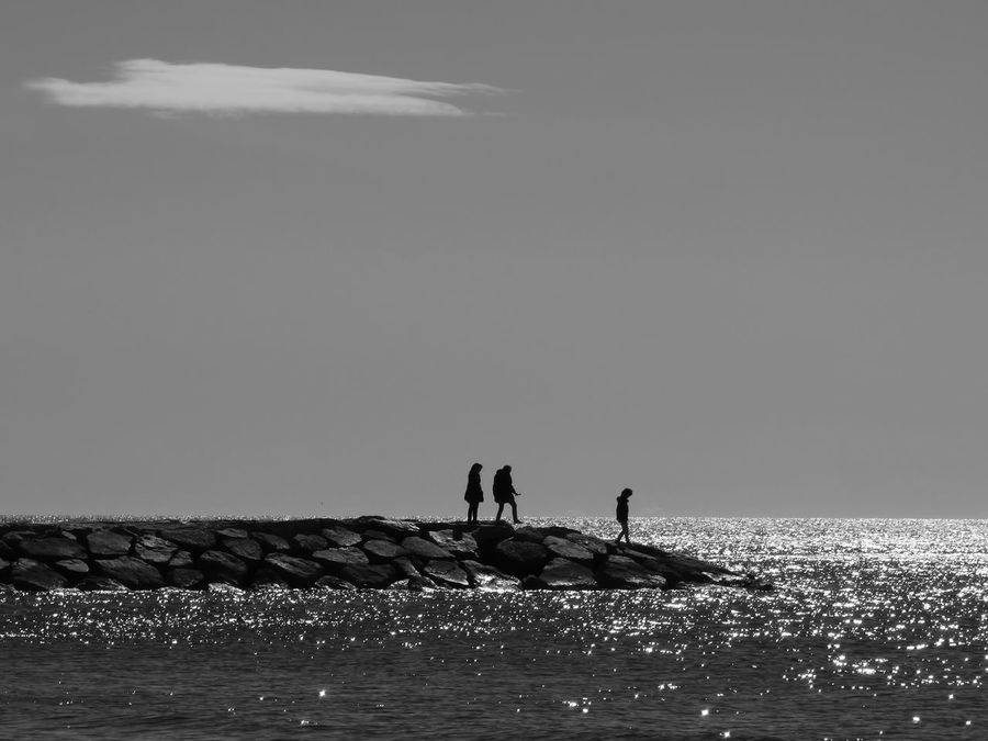 Backlighting Backlighting Photography Beauty In Nature Black And White Day Leisure Activity Nature Outdoors Real People Sea Silhouettes Sky Water