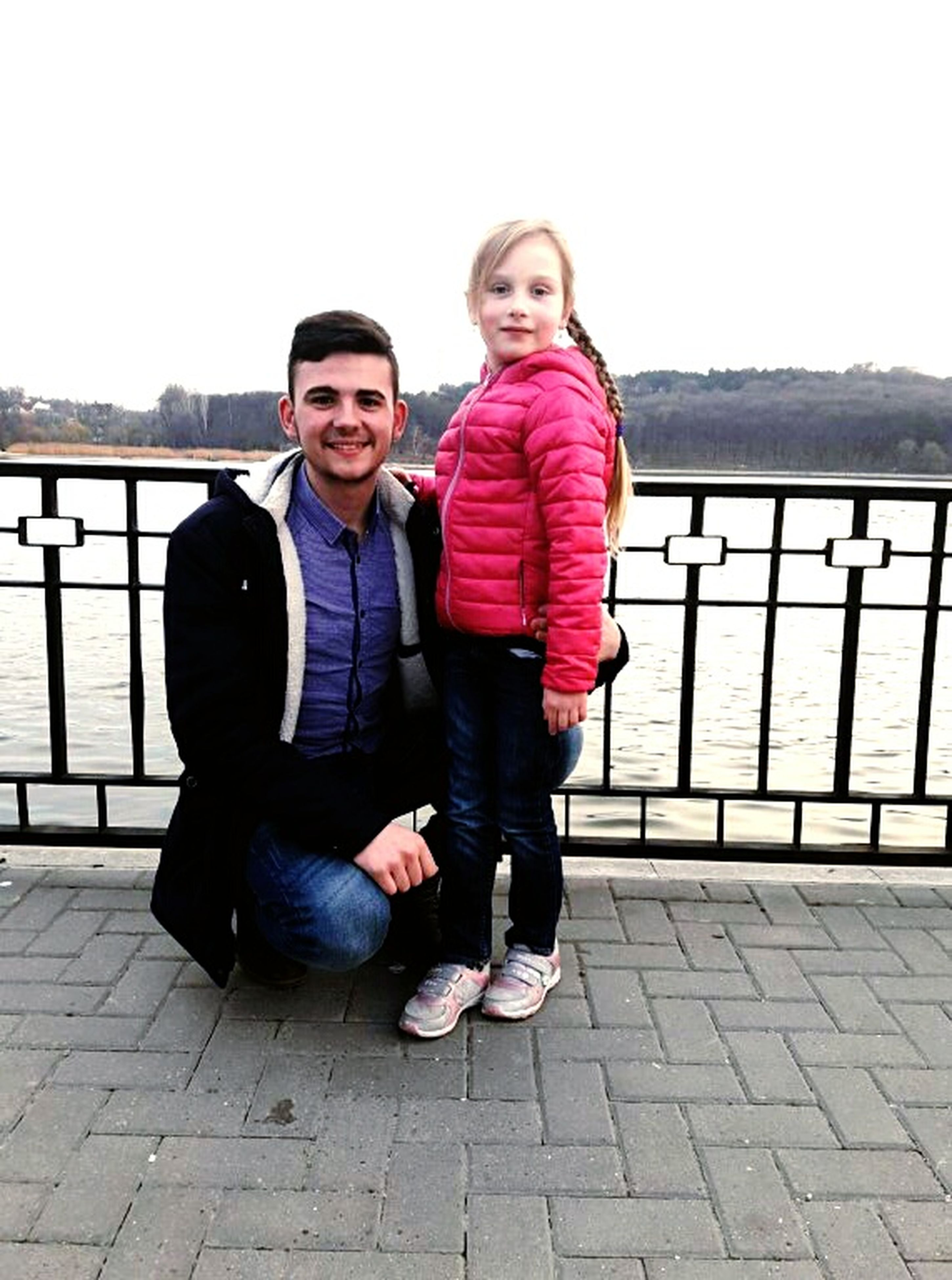 two people, full length, looking at camera, togetherness, blond hair, portrait, happiness, leisure activity, people, smiling, bonding, outdoors, day, front view, standing, lifestyles, adult, hood - clothing, adults only, friendship, sky, sports clothing, young women, cheerful, tracksuit, young adult