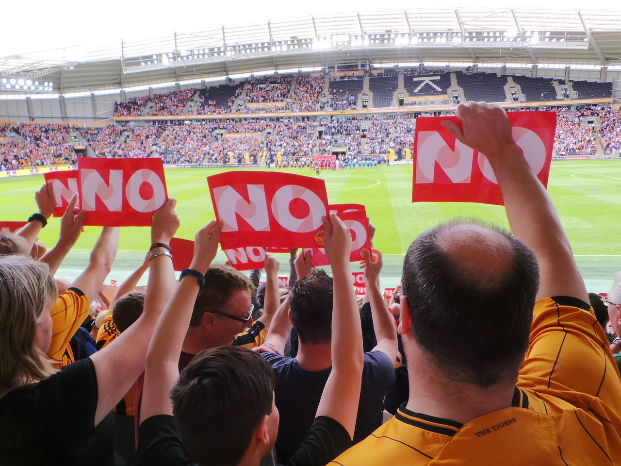 Hull City fans protest at the club owners (the Allams) imposition of a membership scheme which discriminates against children, OAPs and the disabled Adult Adults Only AllamOut Crowd Day Football Hull 2017 Hull City Hull City Of Culture 2017 Hull2017 KCOM Stadium Nature Outdoors People Placards Protecting Where We Play Protest Signs Soccer Stadium