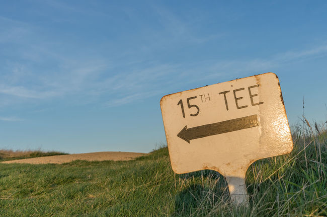 This way to the 15th Tee 15 15th Blue Communication Countryside Creativity Day Field Golf Golfing Grass Grassy Green Color Growth Horizon Over Land Landscape No People Non-urban Scene Outdoors Plant Scenics Sky Tee Text Western Script