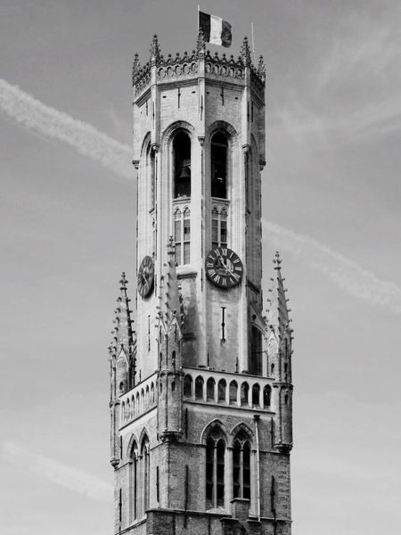 Religion Low Angle View Place Of Worship Spirituality Architecture History Built Structure Building Exterior Belgium Brugge Edendessart Sky Day Clock Tower Outdoors No People Cloud - Sky Travel Destinations Bell Tower Clock Ancient Civilization