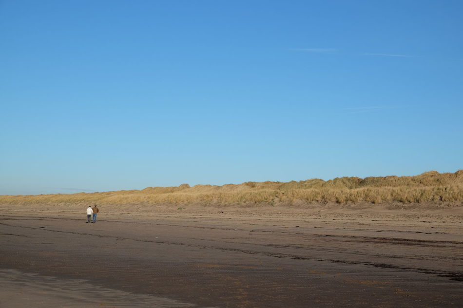 Beautiful beach walk, on a perfect Winter's day, from Prestwich to Troon Beach Beach Grass Beachphotography Beauty In Nature Blue Sky Clear Sky Day Landscape Nature One Person Outdoors People Real People Scotland Scottish Beaches Sky EyEmNewHere