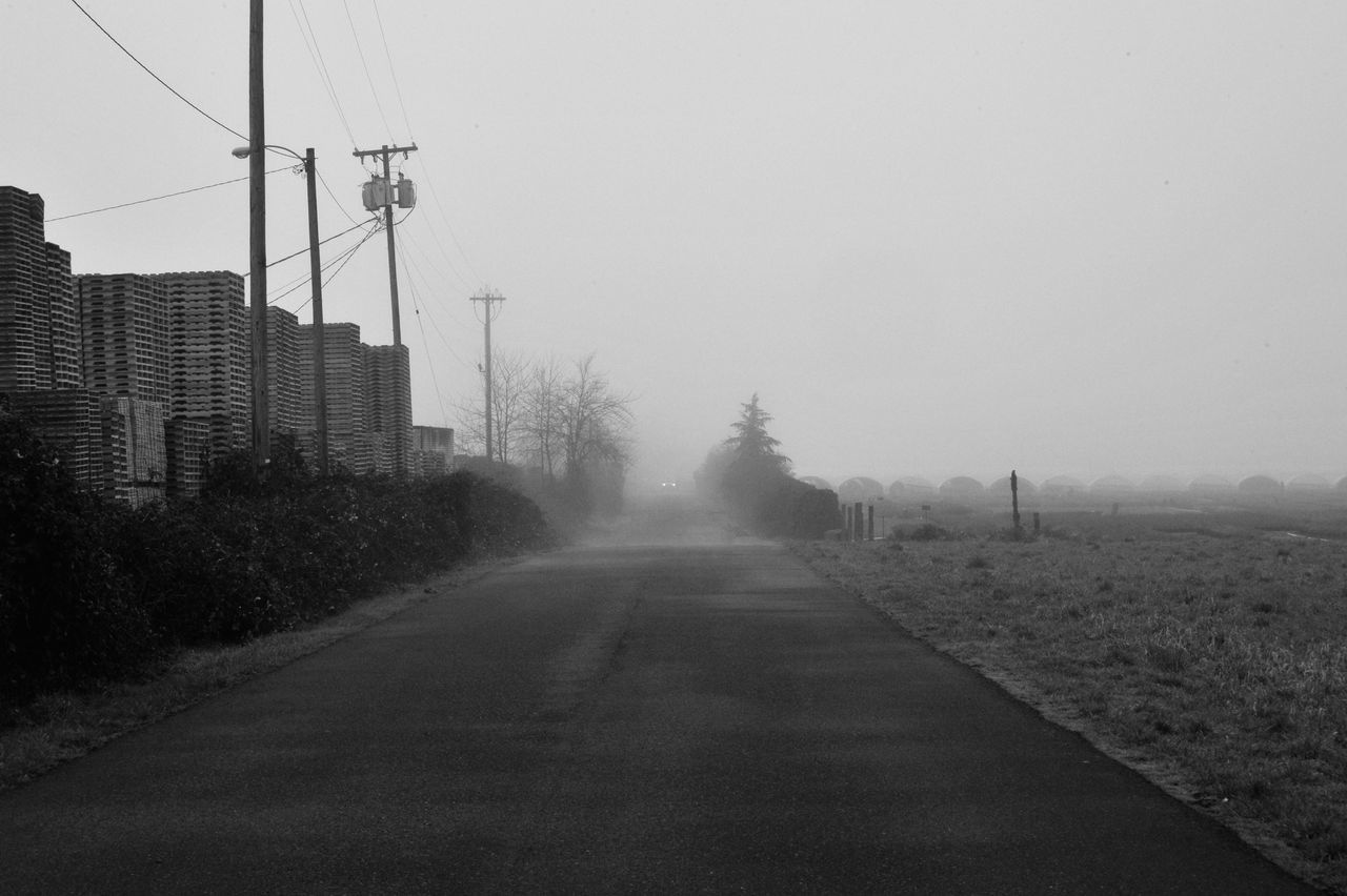 Foggy Day Electricity Pylon Foggy Day Land Vehicle Mode Of Transport Monochromatic Nature No People Outdoors Road Sky The Way Forward Transportation Tree