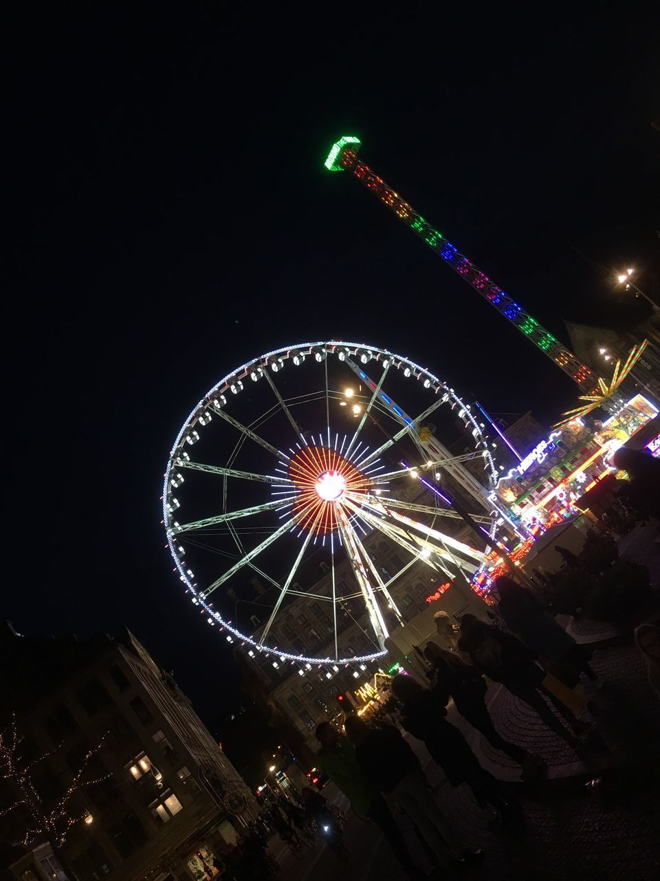 night, illuminated, arts culture and entertainment, built structure, amusement park, architecture, low angle view, building exterior, amusement park ride, ferris wheel, outdoors, no people, big wheel, sky, clear sky, city