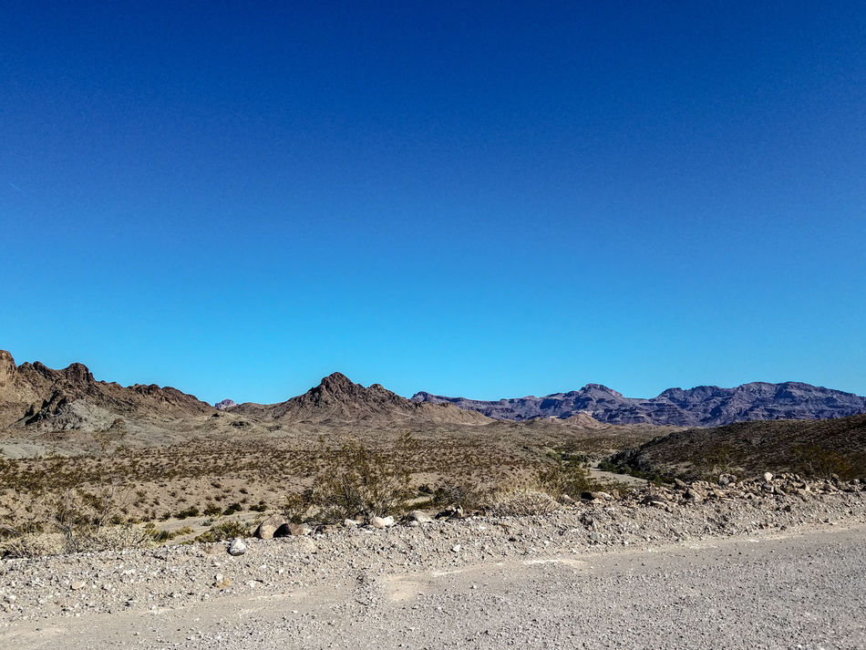Blue Desert Clear Sky No People Landscape Nature Outdoors Sky Day Dirt Rocky Rocks Adventure Explore Travel Along The Road Gravel Plants Dry Mountains USA Arizona Arizona Landscape Mountain Scenics