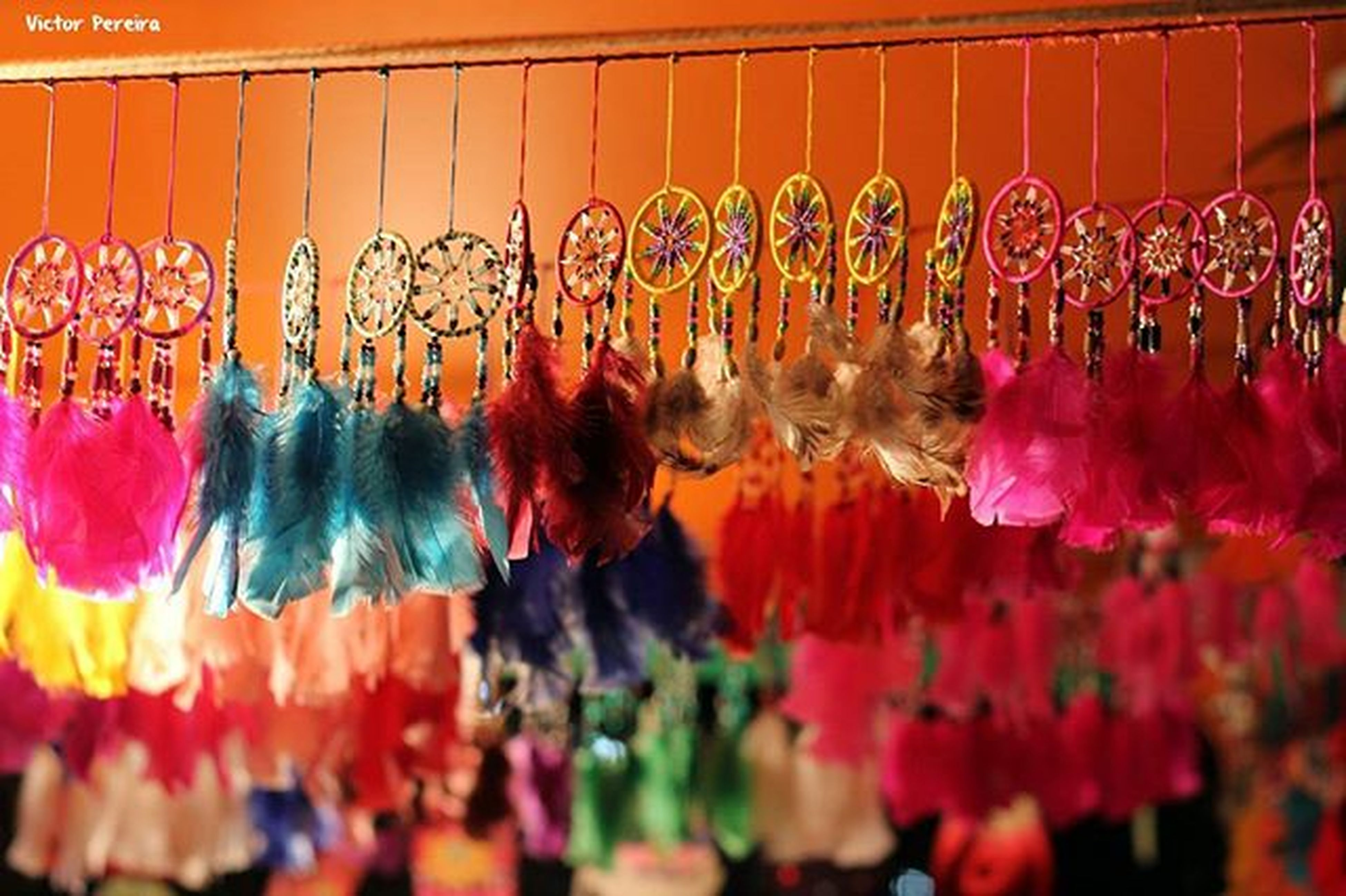 indoors, multi colored, variation, abundance, celebration, large group of objects, choice, tradition, in a row, cultures, hanging, retail, illuminated, for sale, market stall, art and craft, decoration, selective focus, religion, arts culture and entertainment