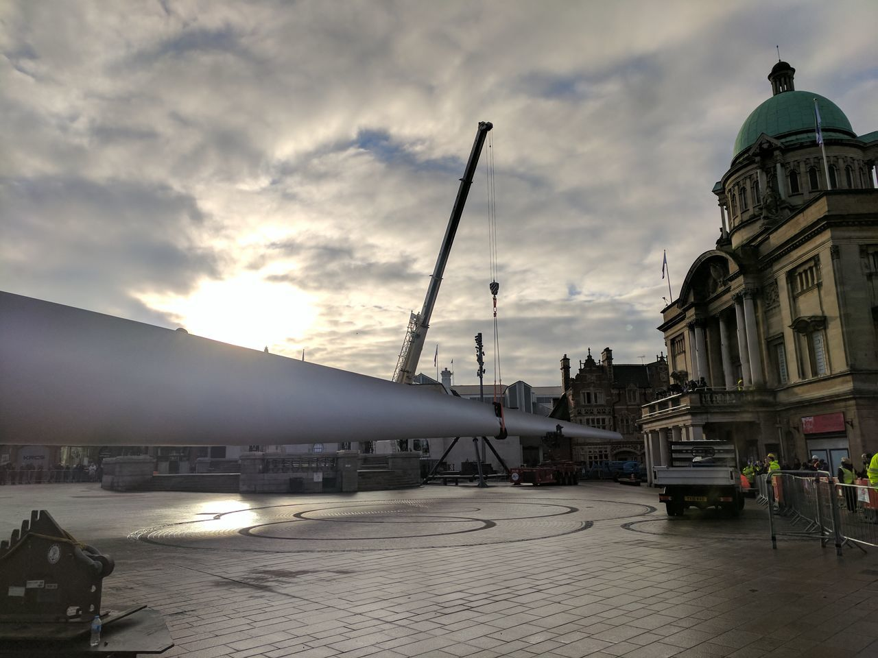 Siemens wind turbine blade is lifted into position in Hull's Queen Victoria Square (08/01/2017) during Hull 2017 City Of Culture Architecture Blackandwhite Building Exterior Built Structure City City Hall Cloud - Sky Day Hull Hull 2017 Hull City Of Culture 2017 Hull2017 Human Body Part No People Outdoors Siemens  Sky Travel Travel Destinations Turbine Wind Turbine