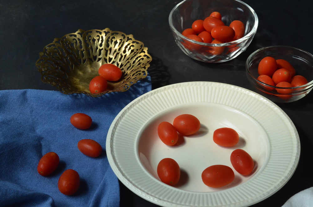 still life with Grape tomatoes Arrangement Bowl Choice Food Fresh Produce Freshness Grape Tomatoes Group Of Objects Healthy Eating Indoors  Indulgence Order Organic Plate Ready-to-eat Red Still Life Table Tomatoes Variation Vegetables