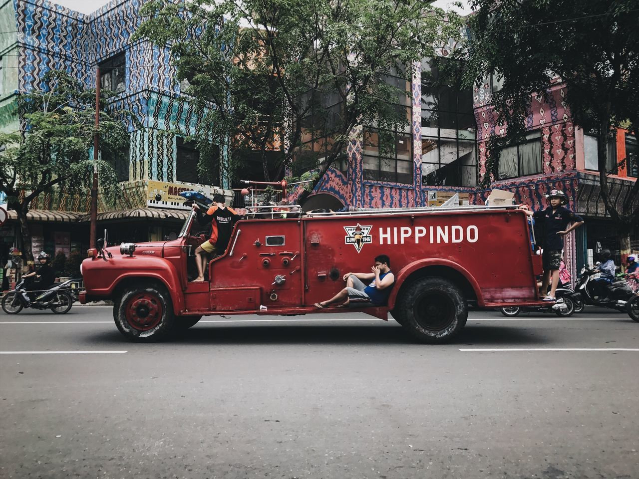Casual Firefighters Land Vehicle Mode Of Transport Transportation Architecture Red Tree Fire Engine Building Exterior Car Outdoors Day Built Structure People Chilling The Street Photographer - 2017 EyeEm Awards