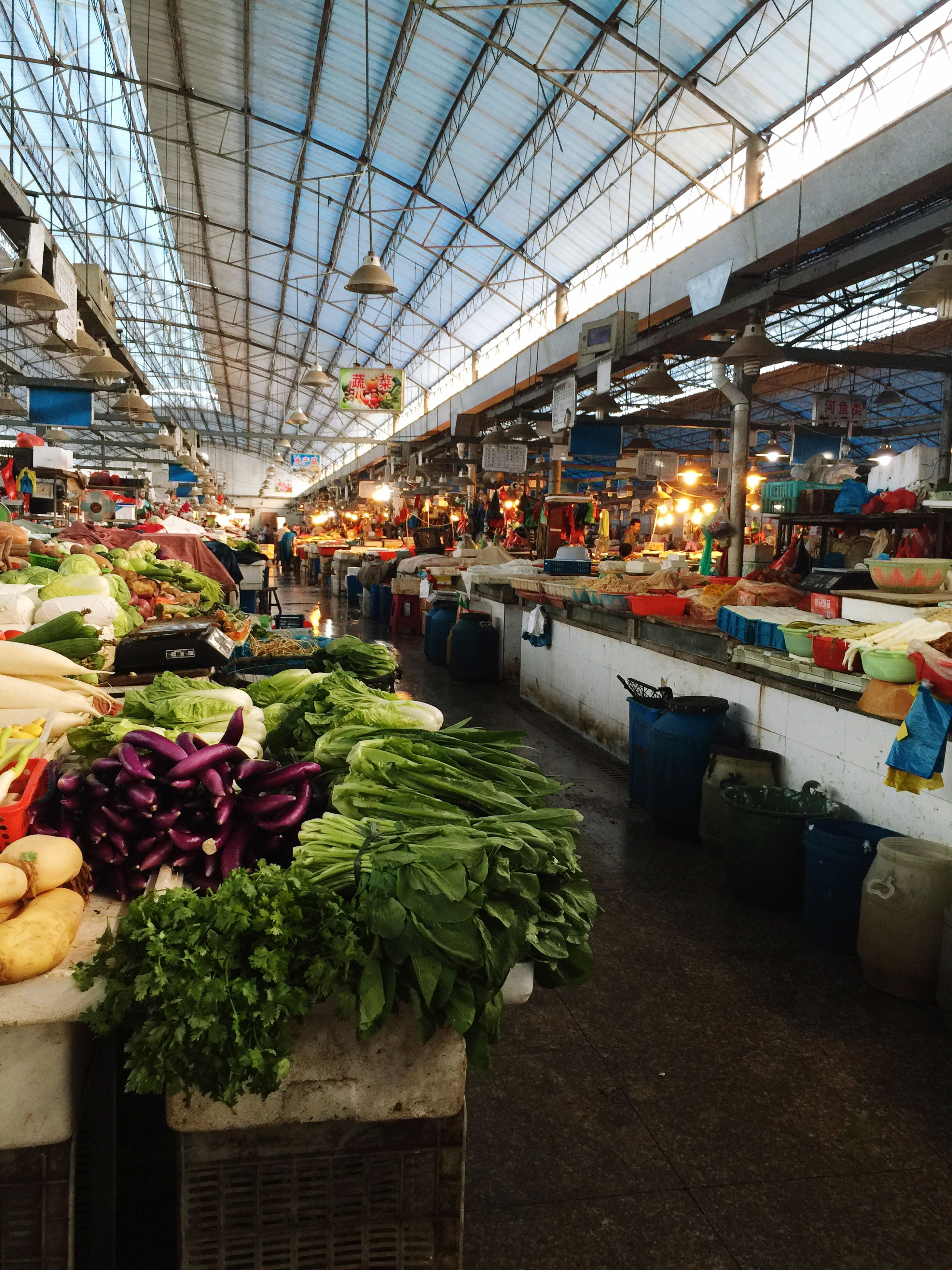 market, retail, market stall, transportation, for sale, city, incidental people, architecture, abundance, store, city life, built structure, mode of transport, choice, consumerism, building exterior, food and drink, large group of objects, shopping, street