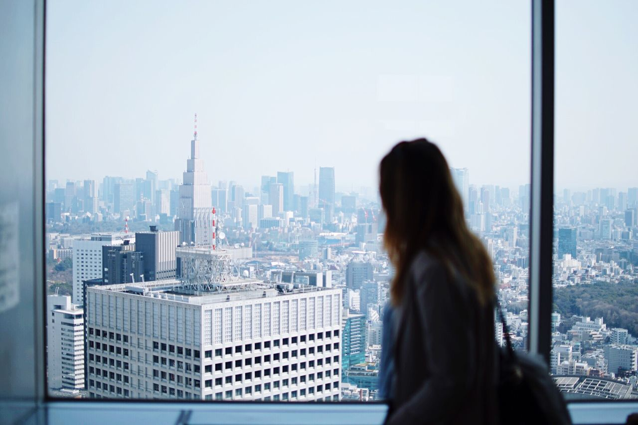 Tokyo View Tranquility Cityscape City Rear view one person Cityscape citylife travel destinations skyscraper only women brown hair one woman only urban skyline Business Adults Only one young woman only Architecture indoors people day young adult downtown district Adult Let's Go. Together.