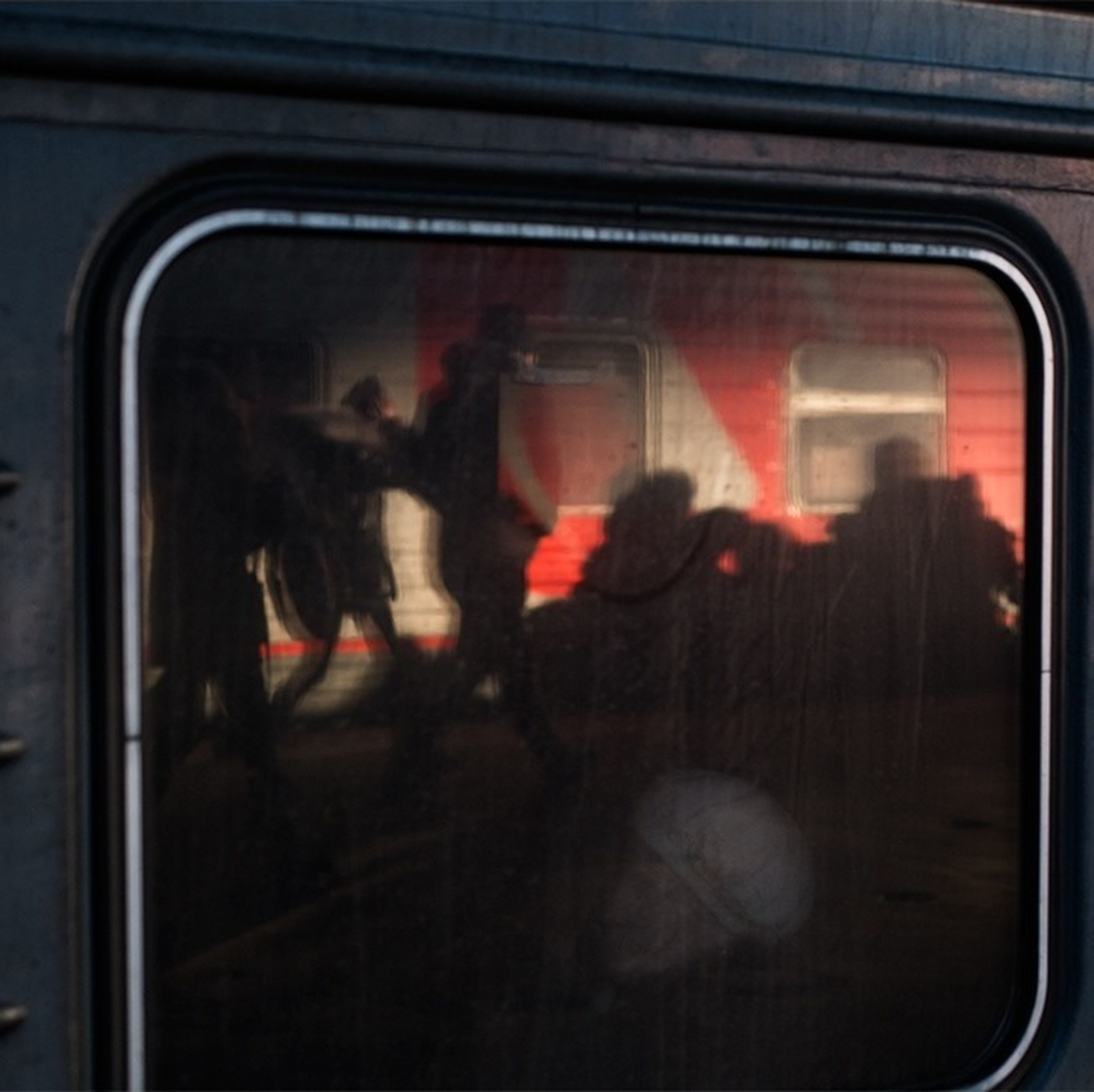 transportation, mode of transport, window, glass - material, indoors, men, lifestyles, transparent, land vehicle, leisure activity, public transportation, person, vehicle interior, travel, reflection, car, train - vehicle, blurred motion