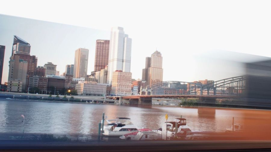Pittsburgh's Downtown while a train is passing Bridge Pittsburgh Pennsylvania Train Skyscraper Architecture City Water Building Exterior River Built Structure