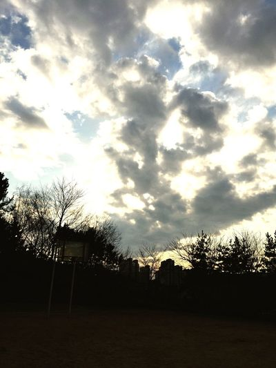 While taking a break after a baseball game with the children viewed the sky...