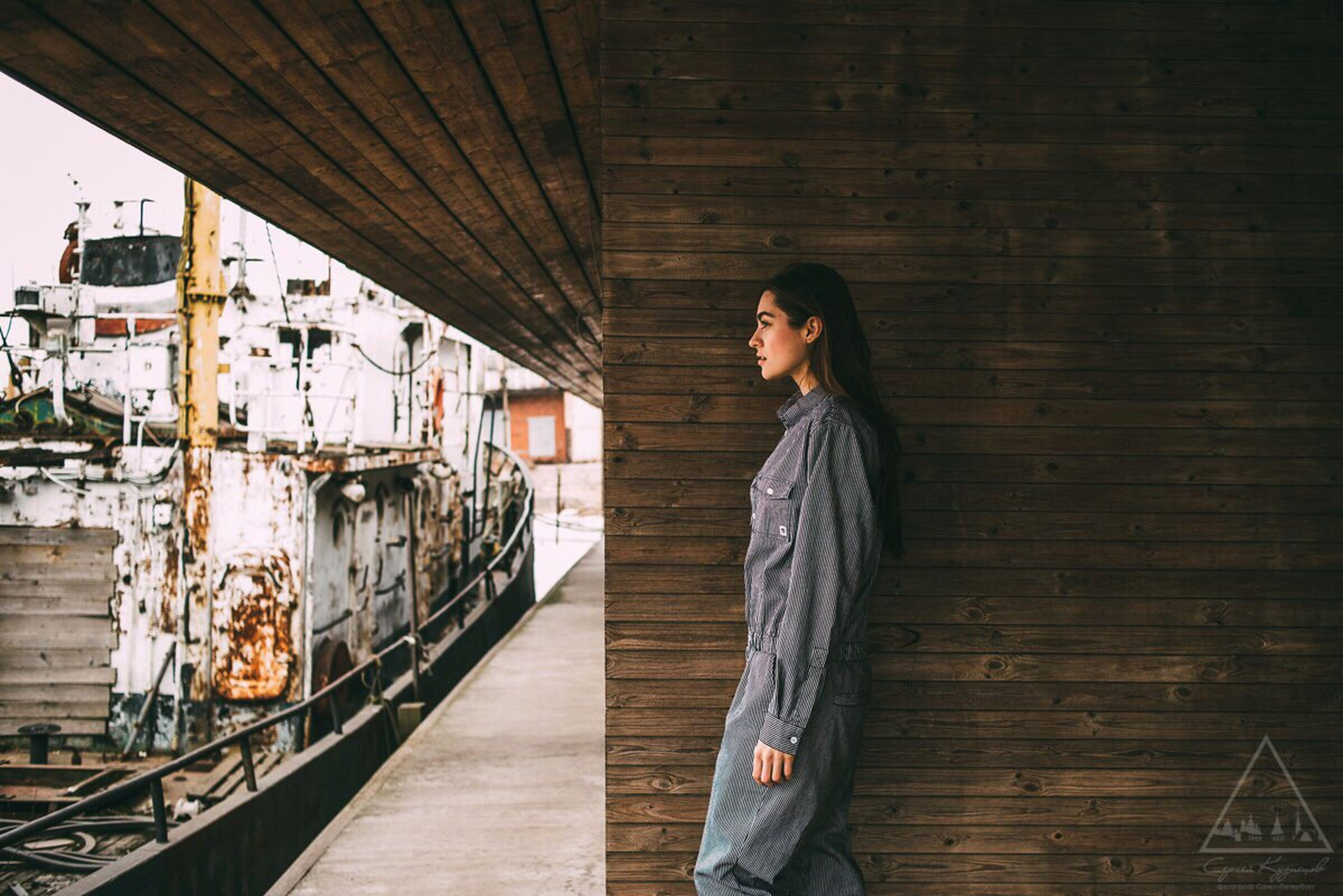 young adult, lifestyles, architecture, person, built structure, casual clothing, young women, standing, leisure activity, front view, looking at camera, full length, portrait, building exterior, wall - building feature, steps, railing