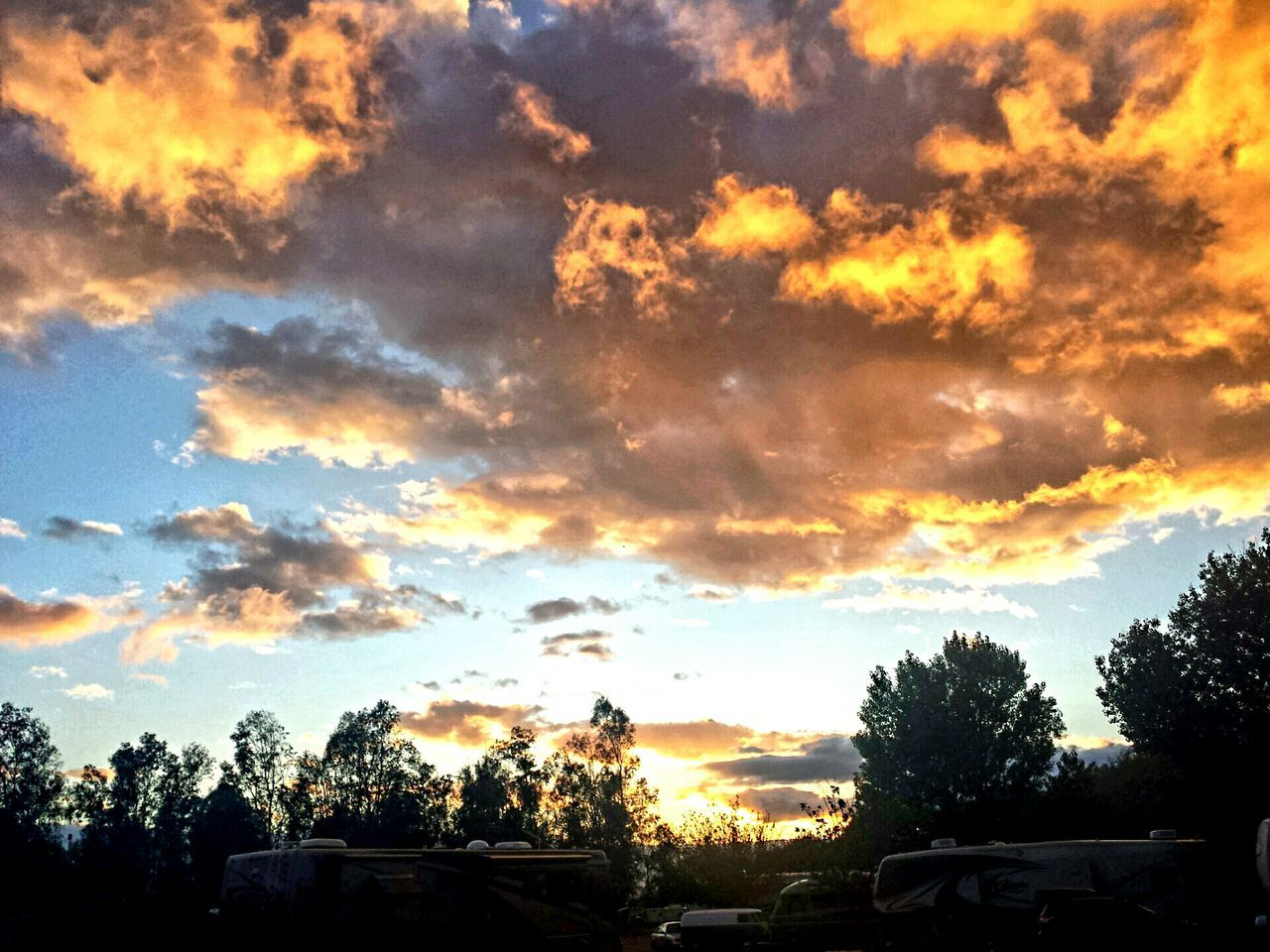 cloud - sky, sunset, sky, tree, car, silhouette, dramatic sky, nature, sun, no people, beauty in nature, land vehicle, outdoors, growth, scenics, day