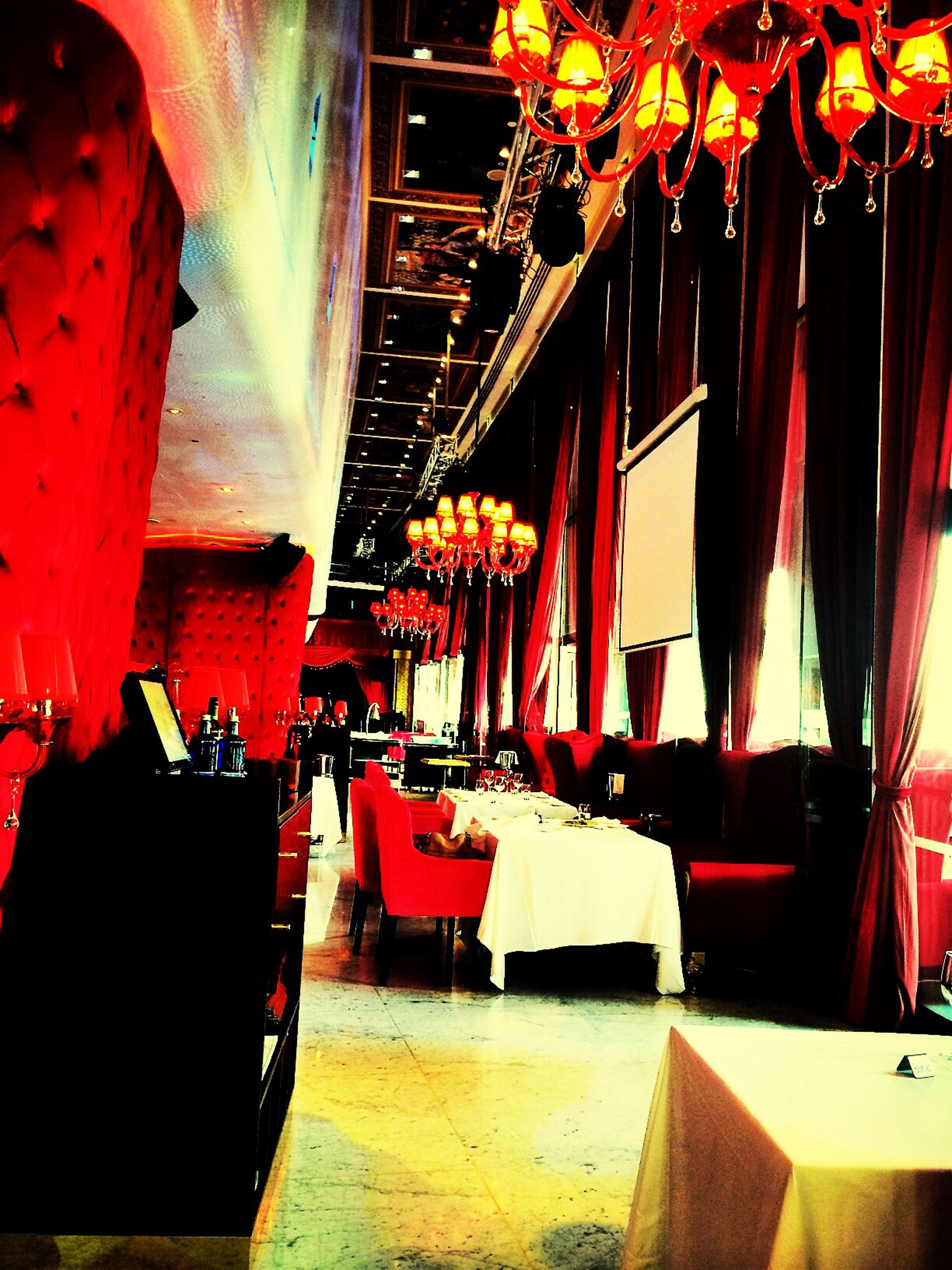 indoors, illuminated, architecture, chair, built structure, hanging, absence, restaurant, table, large group of objects, in a row, arrangement, lighting equipment, empty, no people, window, decoration, ceiling, curtain, sunlight