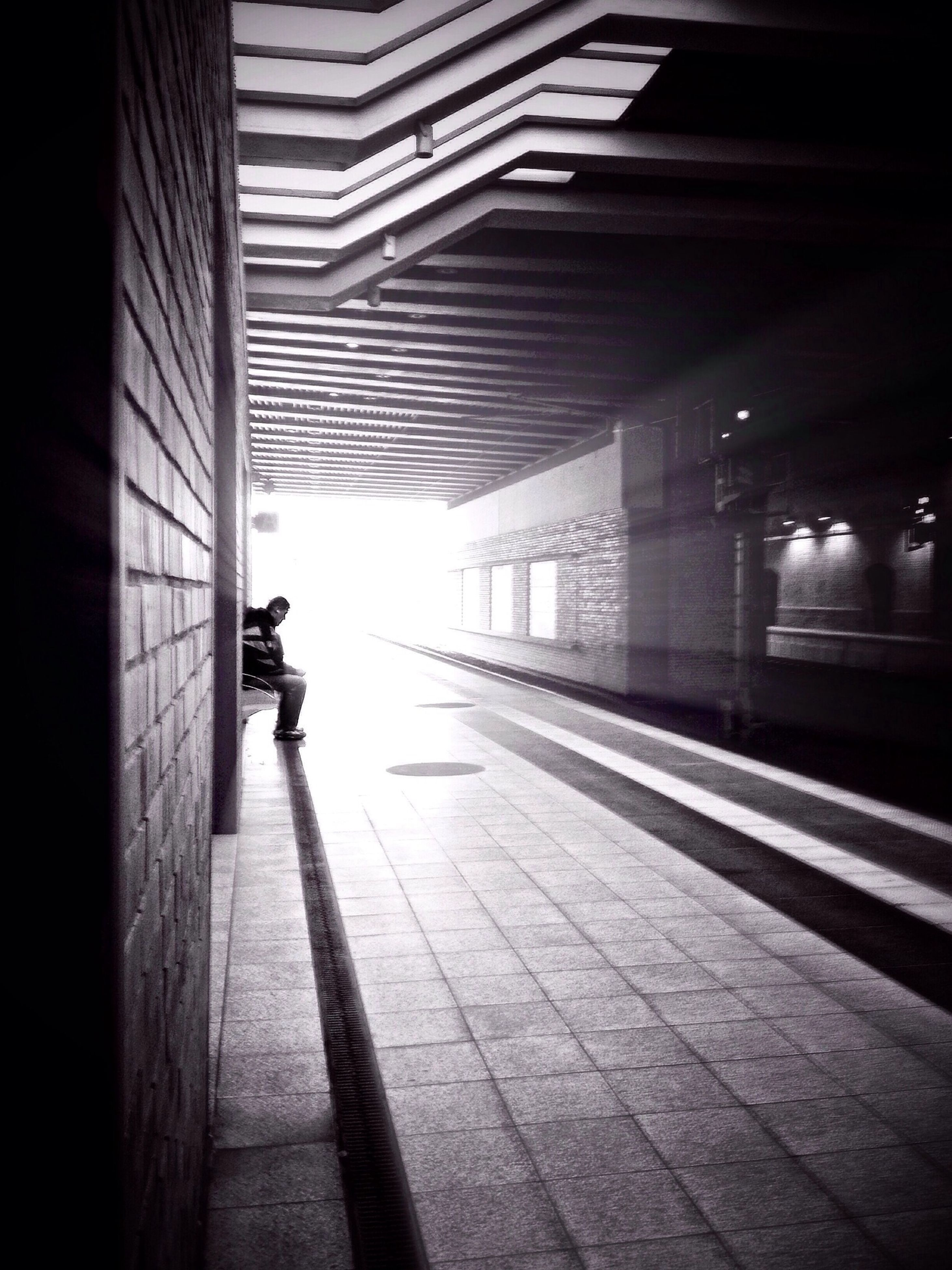 indoors, walking, men, full length, transportation, lifestyles, rear view, railroad station, illuminated, railroad station platform, built structure, person, architecture, on the move, public transportation, subway, the way forward, city life