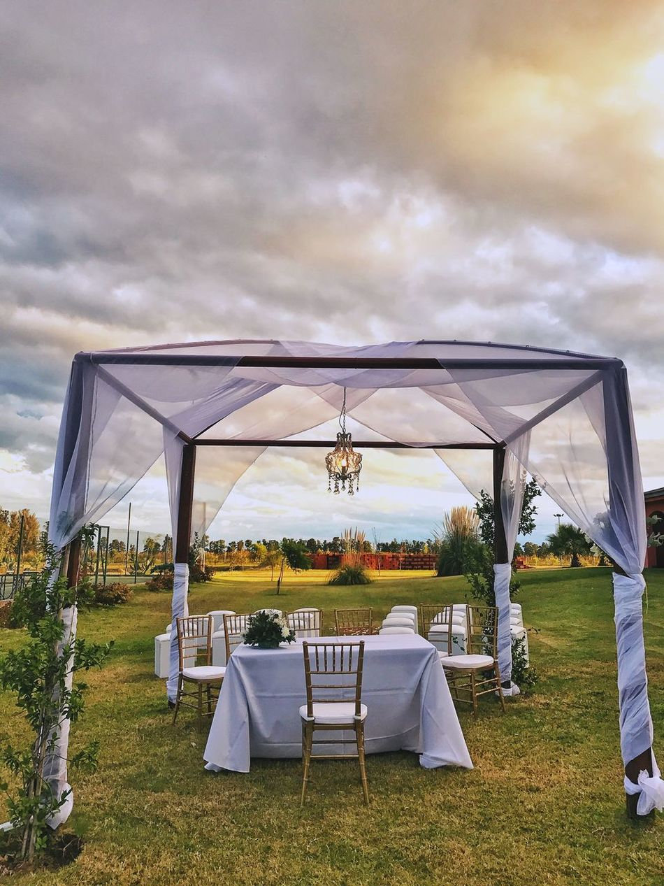 Chair Folding Chair Table Day Tent Nature Wedding No People Grass Sky Outdoors