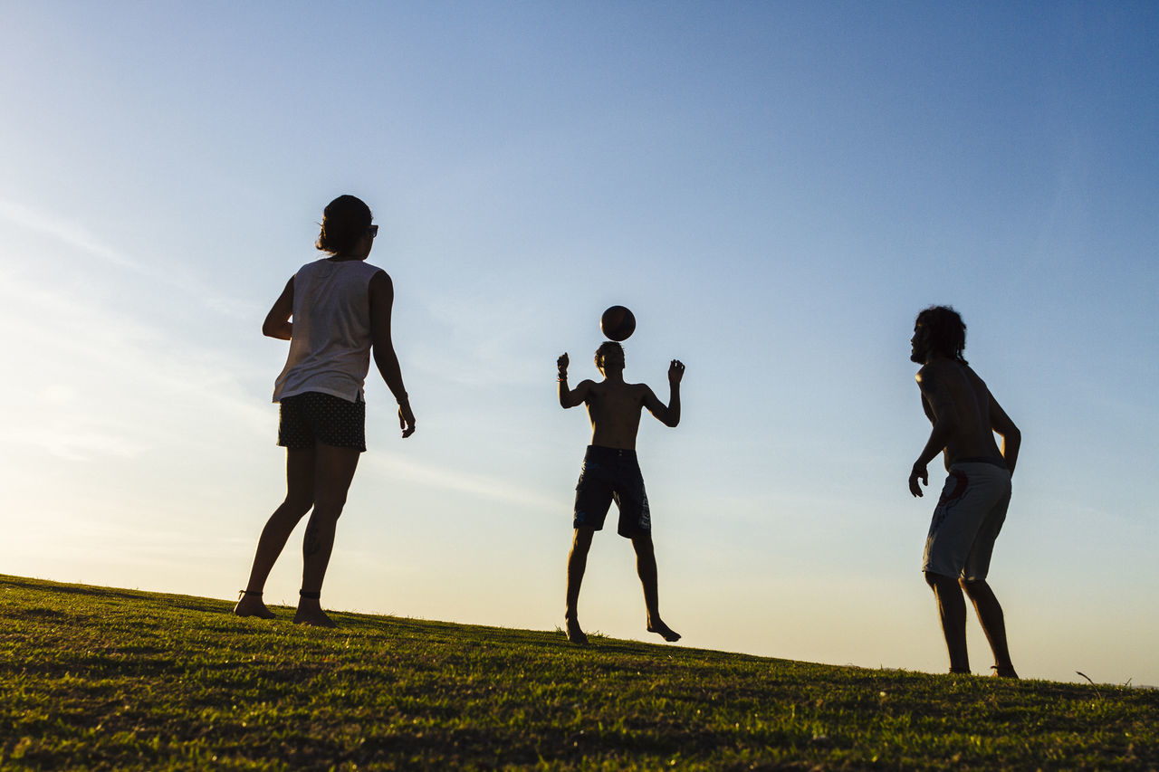 Friends play freestyle soccer in a typical late summer afternoon in Salvador, Bahia Adult Blue Exercising Full Length Group Of People Healthy Lifestyle Leisure Activity Live For The Story Outdoors People Recreational Pursuit Silhouette Silhouette Sky Soccer Sport Togetherness Women