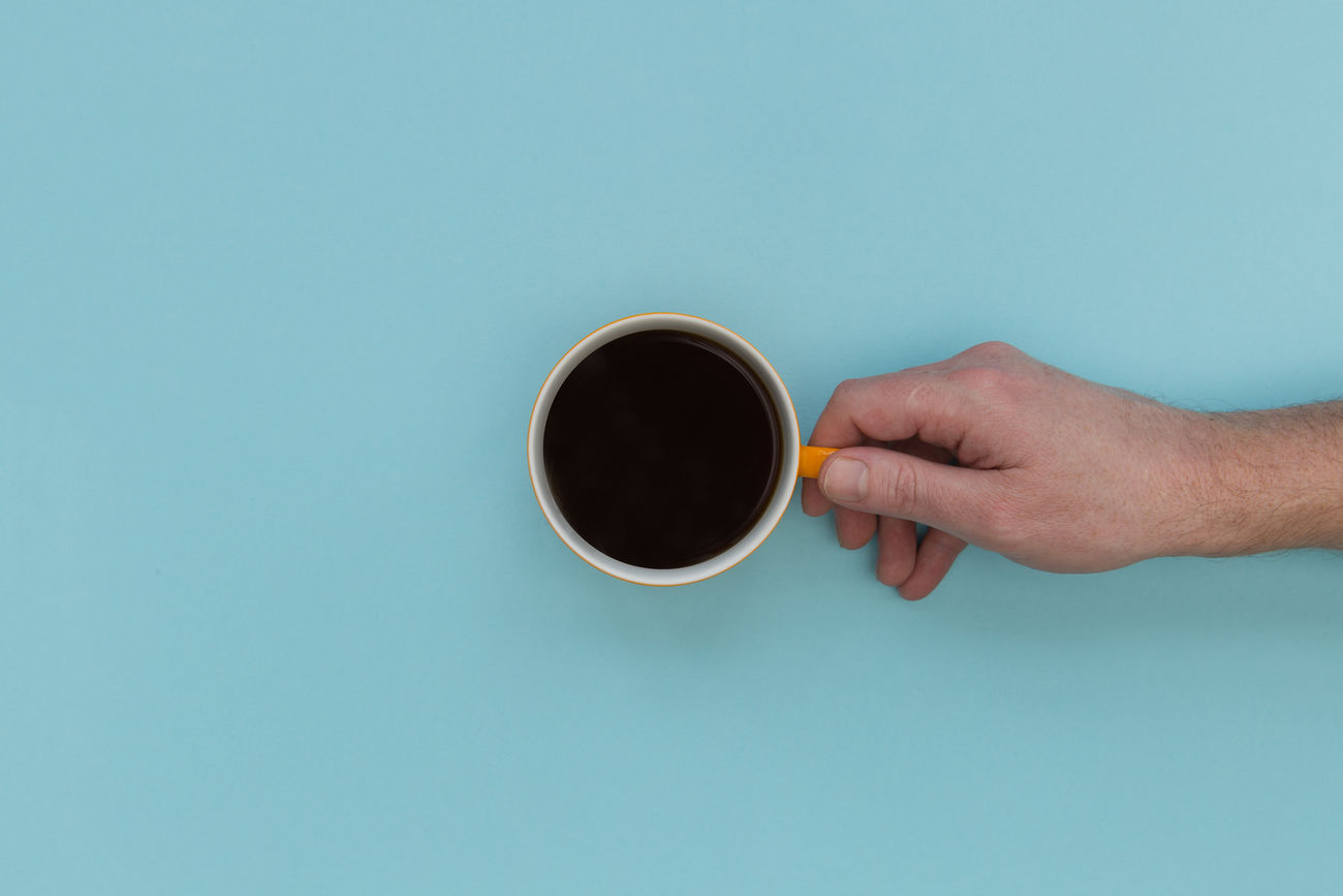 Hand holding coffee Adult Blue Coffee - Drink Coffee Cup Drink Food And Drink Holding Human Hand Minimalism One Person Refreshment Studio Shot