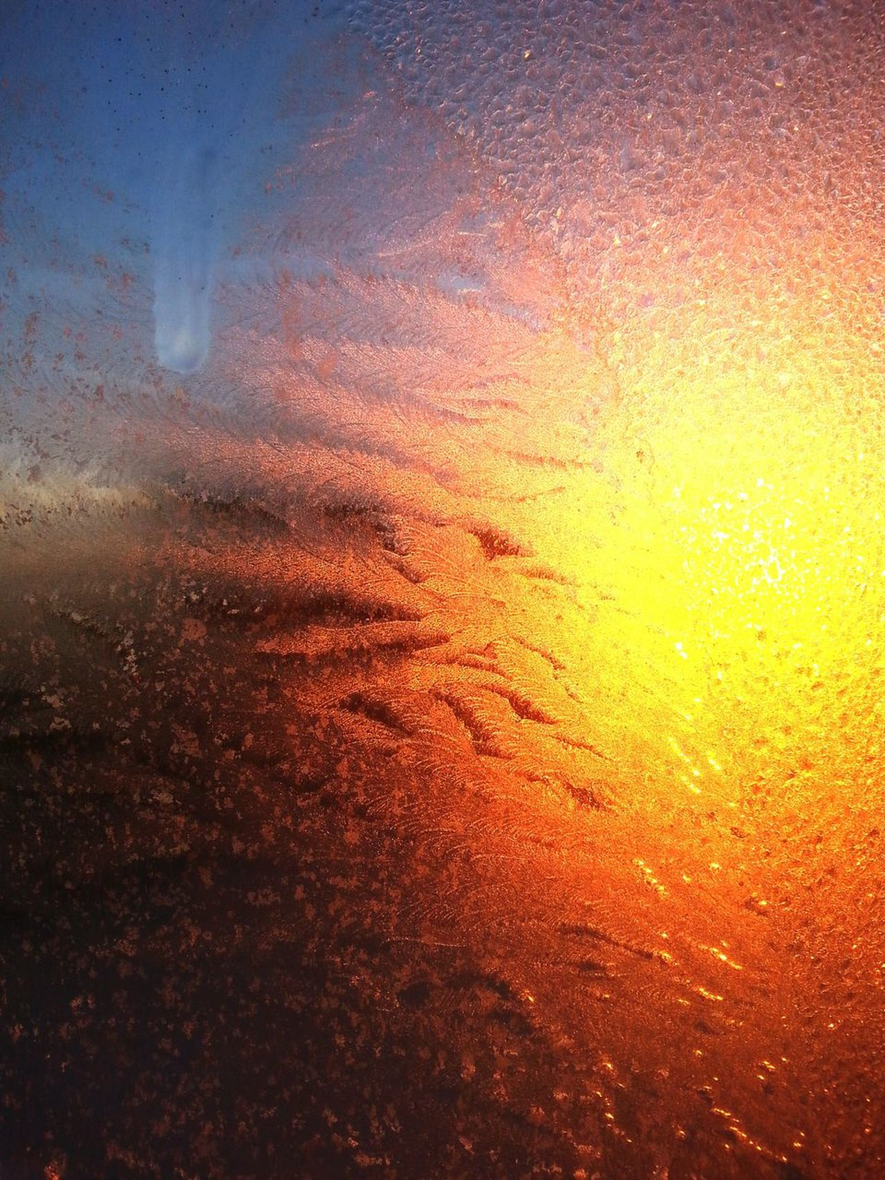 Sunset through an Icy Window .. Nature Is Beautiful