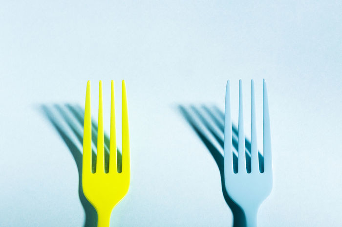 Abstract Background Blue Close-up Closeup Color Concept Cutlery Eating Food Food And Drink Food And Drink Fork Freshness Healthy Eating Isolated Minimalist Saturated Service Shadow Silverware  Studio Shot Surreal Utensil Yellow