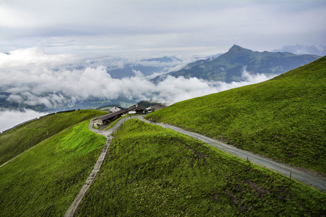 After rain. Foggy summer landscape in the Alps mountains, Tirol, Austria. At the background, Kitzbuhel peak. Agriculture Alps Austria Beauty In Nature Cloud - Sky Countryside Day Dramatic Sky Fog Green Color Holiday House Kitzbühel Landscape Mist Mountain Mountain Peak Mountains Nature No People Outdoors Recreation  Road Summer Weather